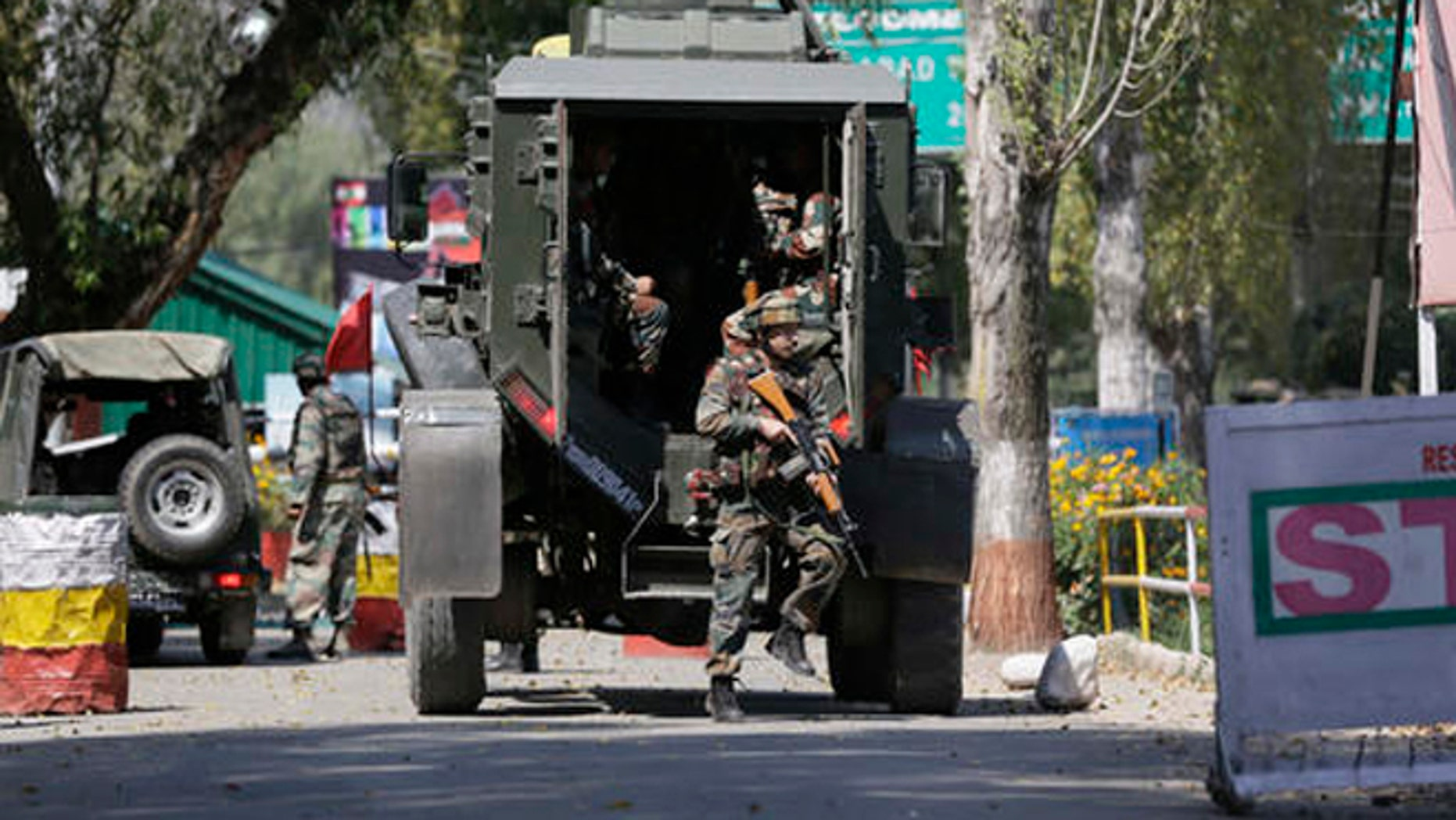 Indian army soldiers arrive at the army base which was attacked by suspected rebels in the town of Uri, west of Srinagar, Indian controlled Kashmir, Sunday.