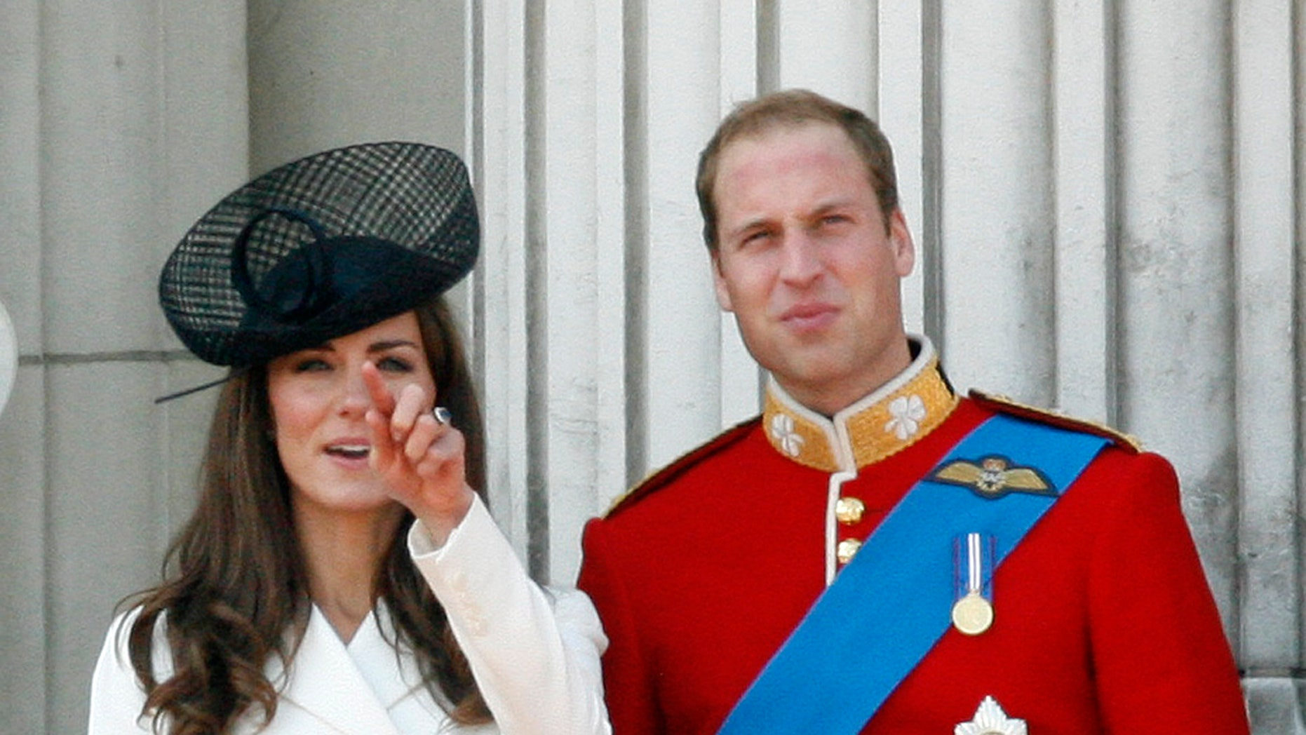 June 11, 2011. Prince William, Duke of Cambridge, right, his wife Catherine, Duchess of Cambridge, react on the balcony of Buckingham Palace after returning from the Trooping the Colour ceremony to mark the Queen's official birthday in London.