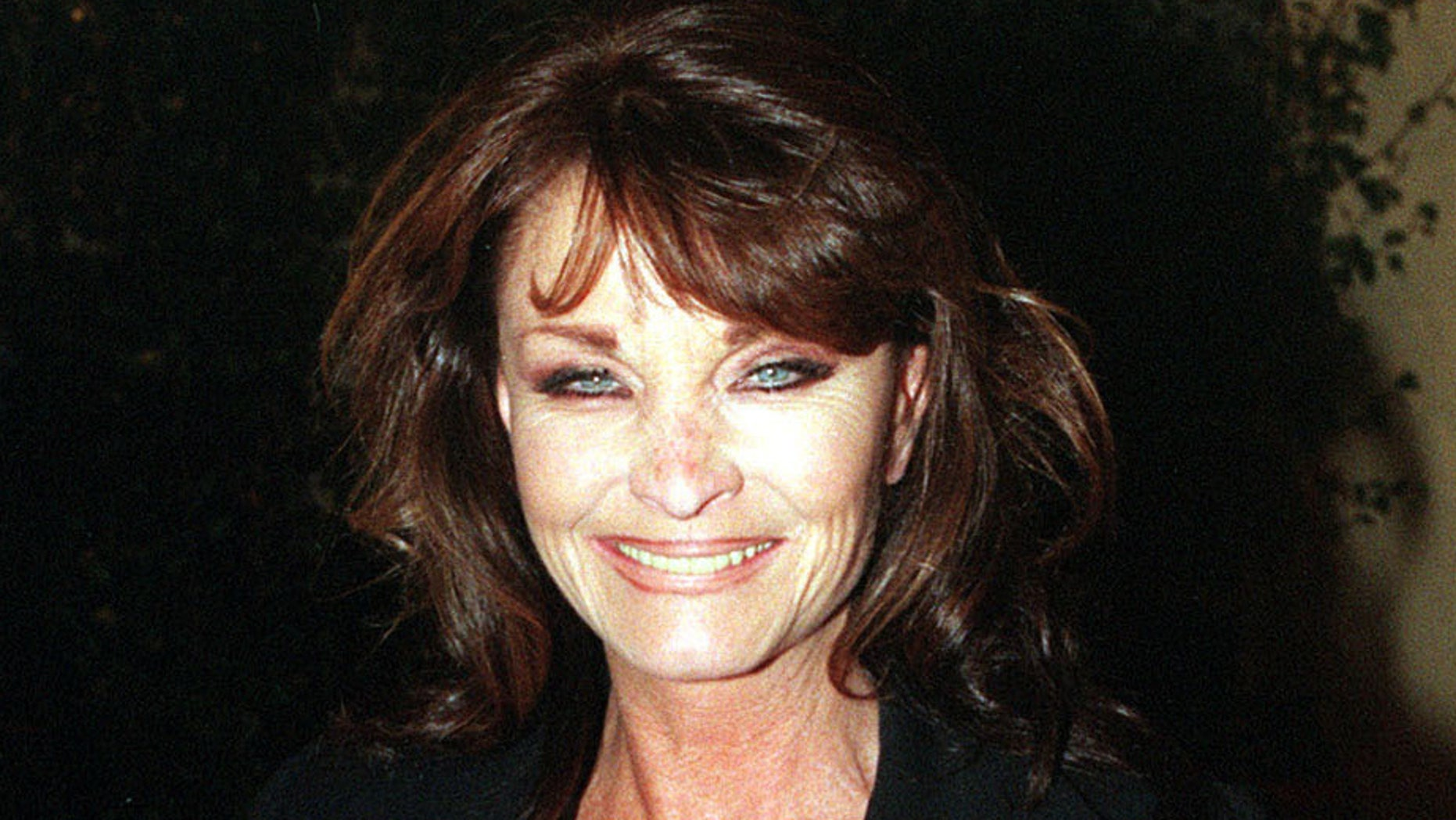 """Oct. 6 1998. British actress Kate O'Mara poses for photographers.  Actress Kate O'Mara, best known for her role in the 1980s soap opera """"Dynasty,"""" has died at the age of 74."""