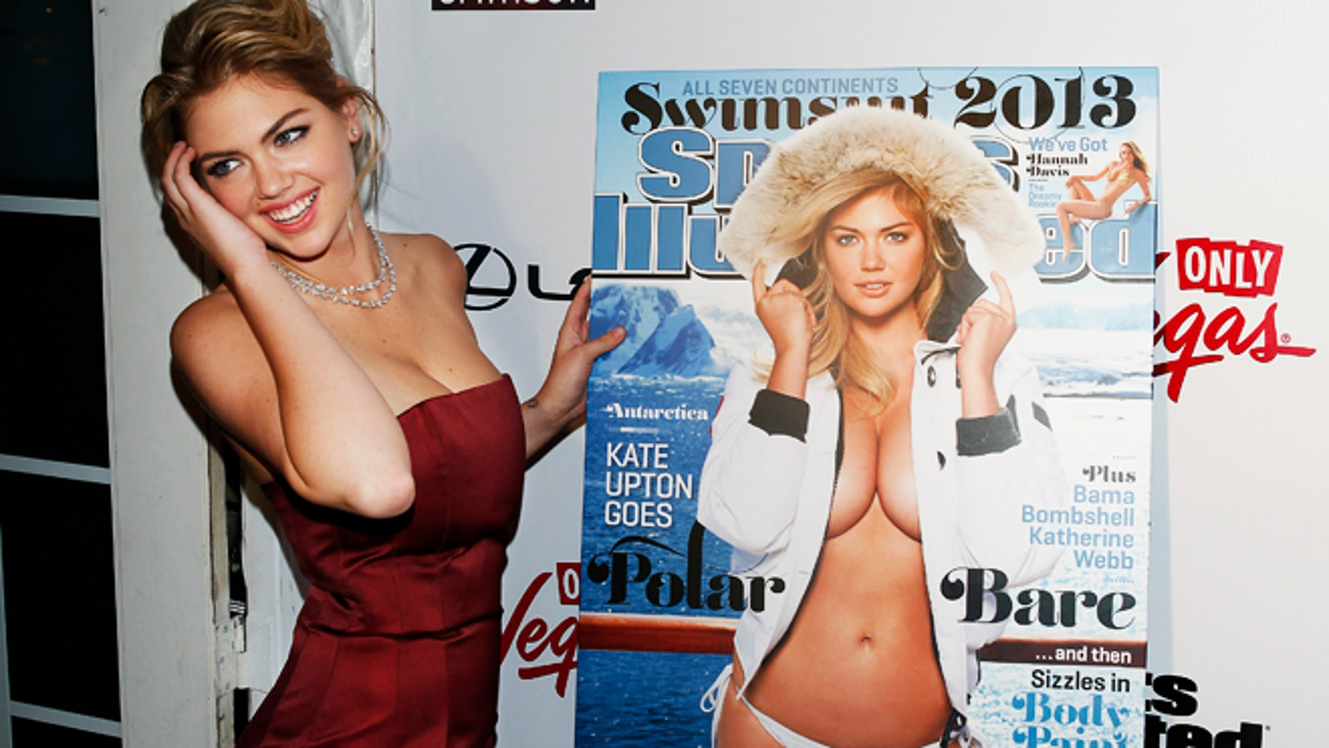Supermodel Kate Upton poses at the launch party of the Sports Illustrated's 2013 Swimsuit issue, which features her on the cover, in New York February 12, 2013.  REUTERS/Carlo Allegri  (UNITED STATES - Tags: ENTERTAINMENT SPORT) - RTR3DPHG