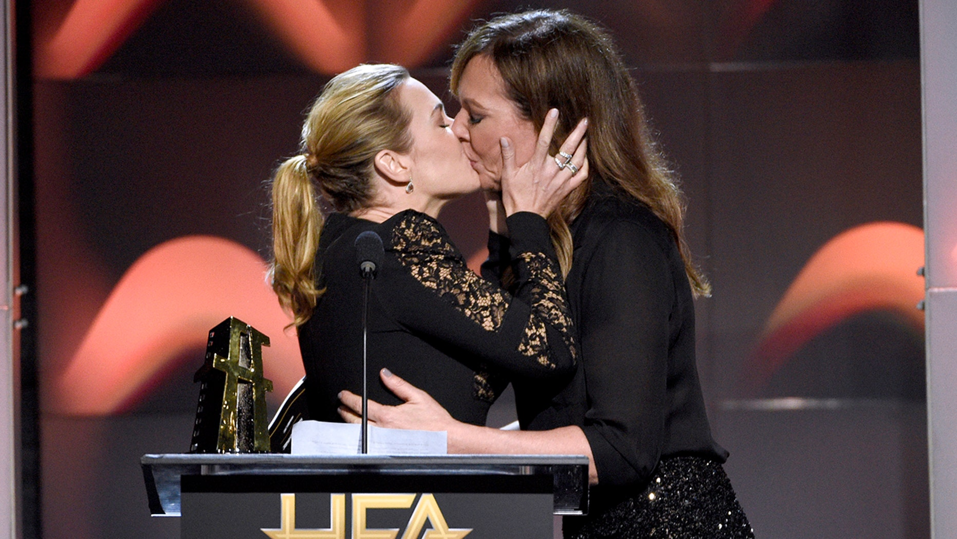 """Allison Janney, right, kisses Kate Winslet, winner of the Hollywood actress award for """"Wonder Wheel"""" at the Hollywood Film Awards at the Beverly Hilton hotel on Sunday, Nov. 5, 2017, in Beverly Hills, Calif. (Photo by Chris Pizzello/Invision/AP)"""