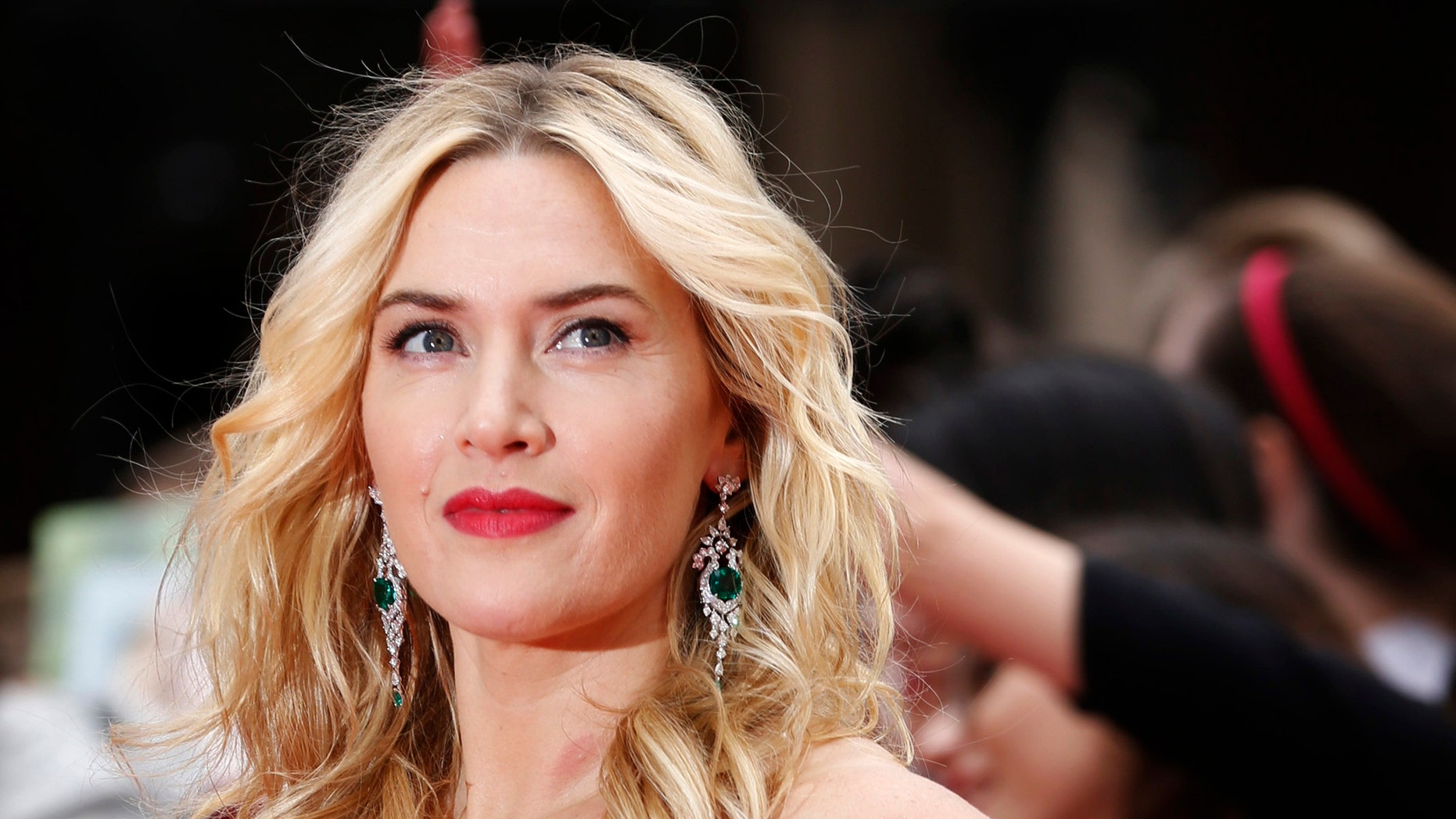 "March 30, 2014. Actress Kate Winslet poses for a photograph as she arrives for the European premiere of ""Divergent"" at Leicester Square in London."