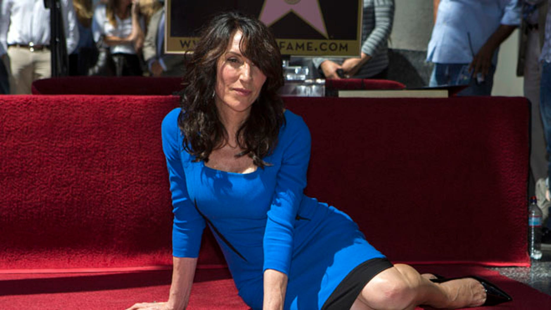 September 9, 2014. Actress Katey Sagal poses on her star after it was unveiled on the Walk of Fame in Hollywood, California.