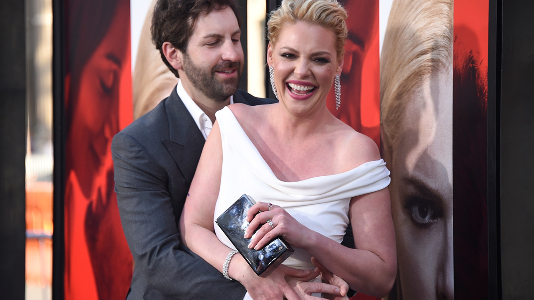 """Cast member Katherine Heigl (R) and Josh Kelley attend the premiere of """"Unforgettable"""" in Los Angeles, California, U.S. April 18, 2017."""