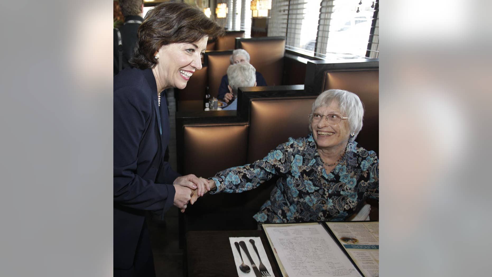 Congresswoman-elect Kathy Hochul, D-NY, left, thanks customers for their support at a restaurant in Depew, N.Y., Wednesday, May 25, 2011. (AP Photo/David Duprey)