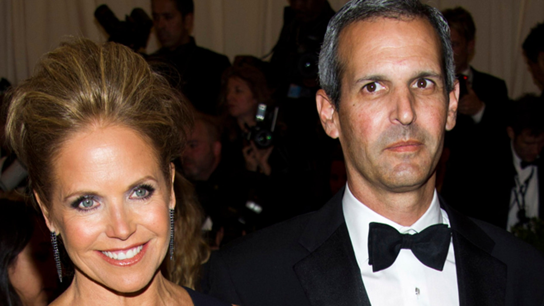 """May 6, 2013: In this file photo, TV personality Katie Couric, left, and John Molner attend The Metropolitan Museum of Art's Costume Institute benefit celebrating """"PUNK: Chaos to Couture"""" in New York. Couric has married Molner in a small ceremony at her East Hampton home."""