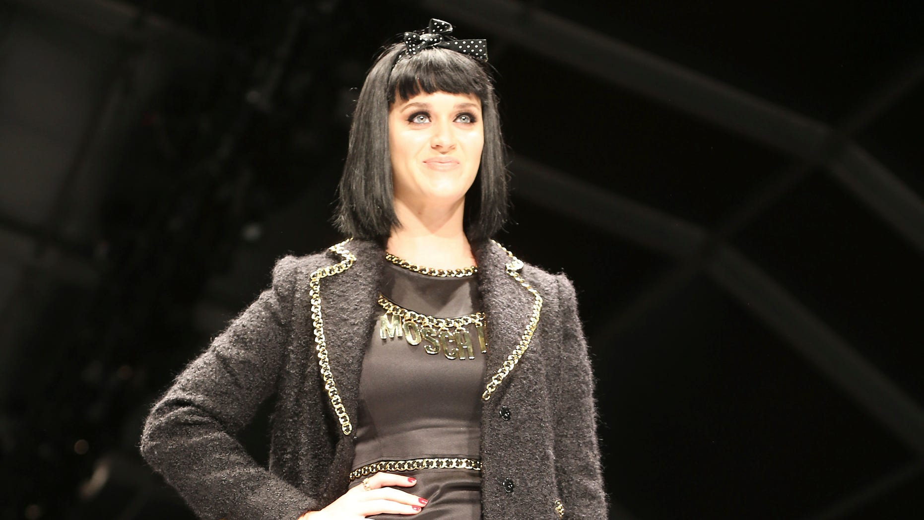 February 20, 2014. Katy Perry poses prior to the start of the Moschino women's Fall-Winter 2014-15 collection, part of the Milan Fashion Week, unveiled in Milan, Italy.