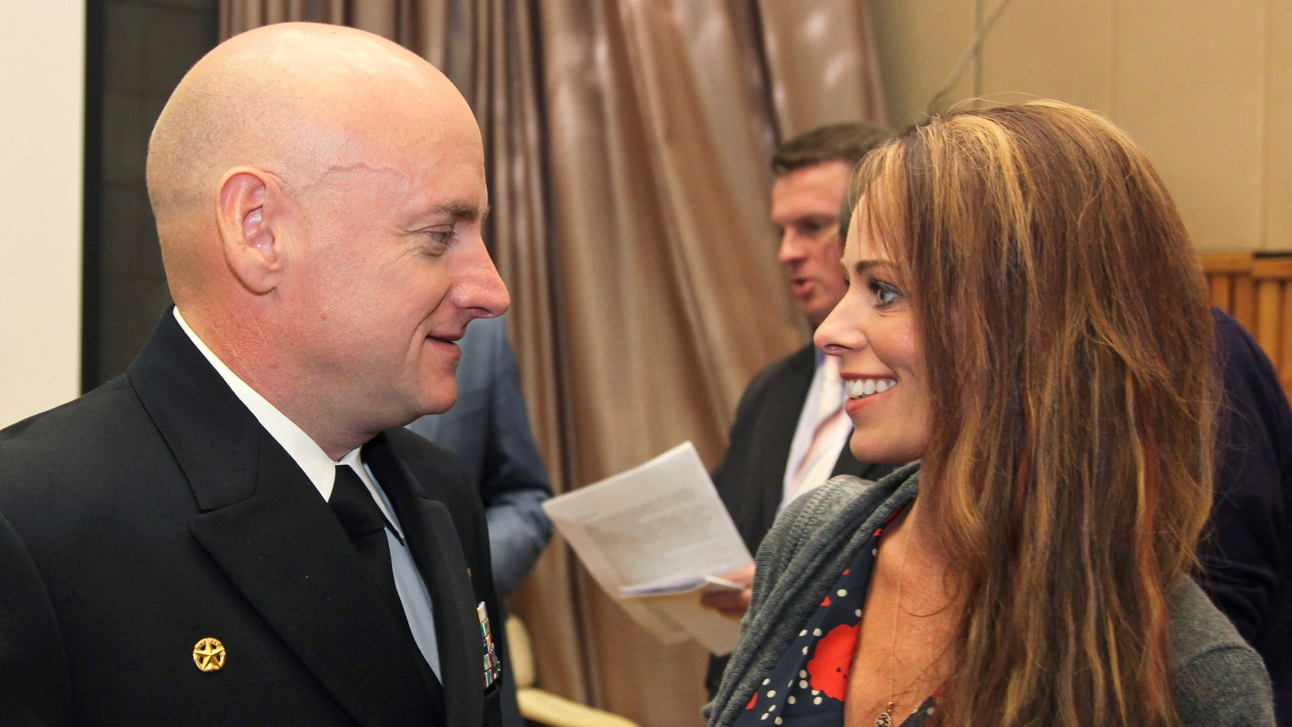 File photo -  Scott Kelly speaks with Amiko Kauderer after a news conference at the Star City space centre outside Moscow, Sept. 17, 2010. (REUTERS/Sergei Remezov)