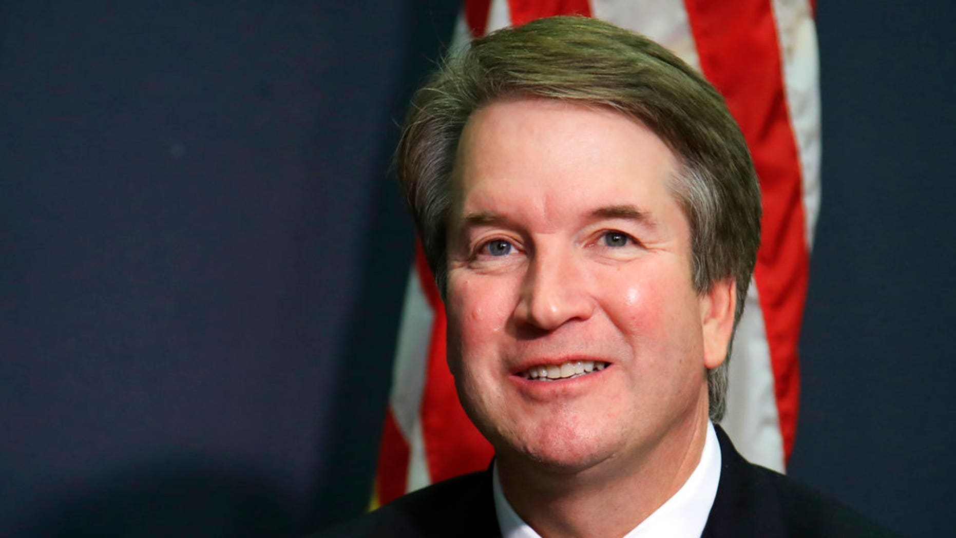 FILE - In this July 19, 2018, file photo, Supreme Court nominee Brett Kavanaugh glances at reporters during a meeting with Sen. James Lankford, R-Okla., on Capitol Hill in Washington. Kavanaugh has been a conservative team player, and the Supreme Court nominee has stepped up to make a play at key moments in politics, government and the law dating to the Bill Clinton era.  (AP Photo/Manuel Balce Ceneta, File)