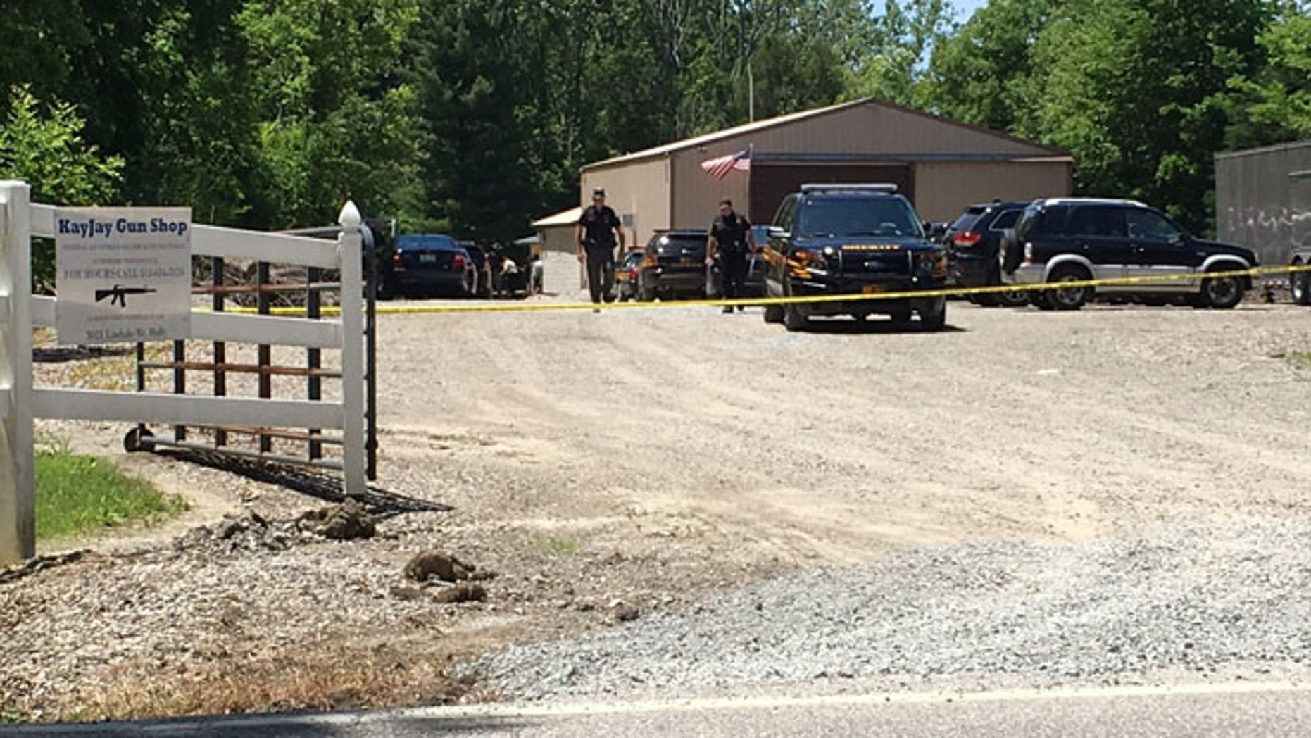Sheriff's deputies investigate accidental shooting at KayJay Gun Shop in Amelia, Ohio. (FOX19 NOW/ Chris Waldmann)