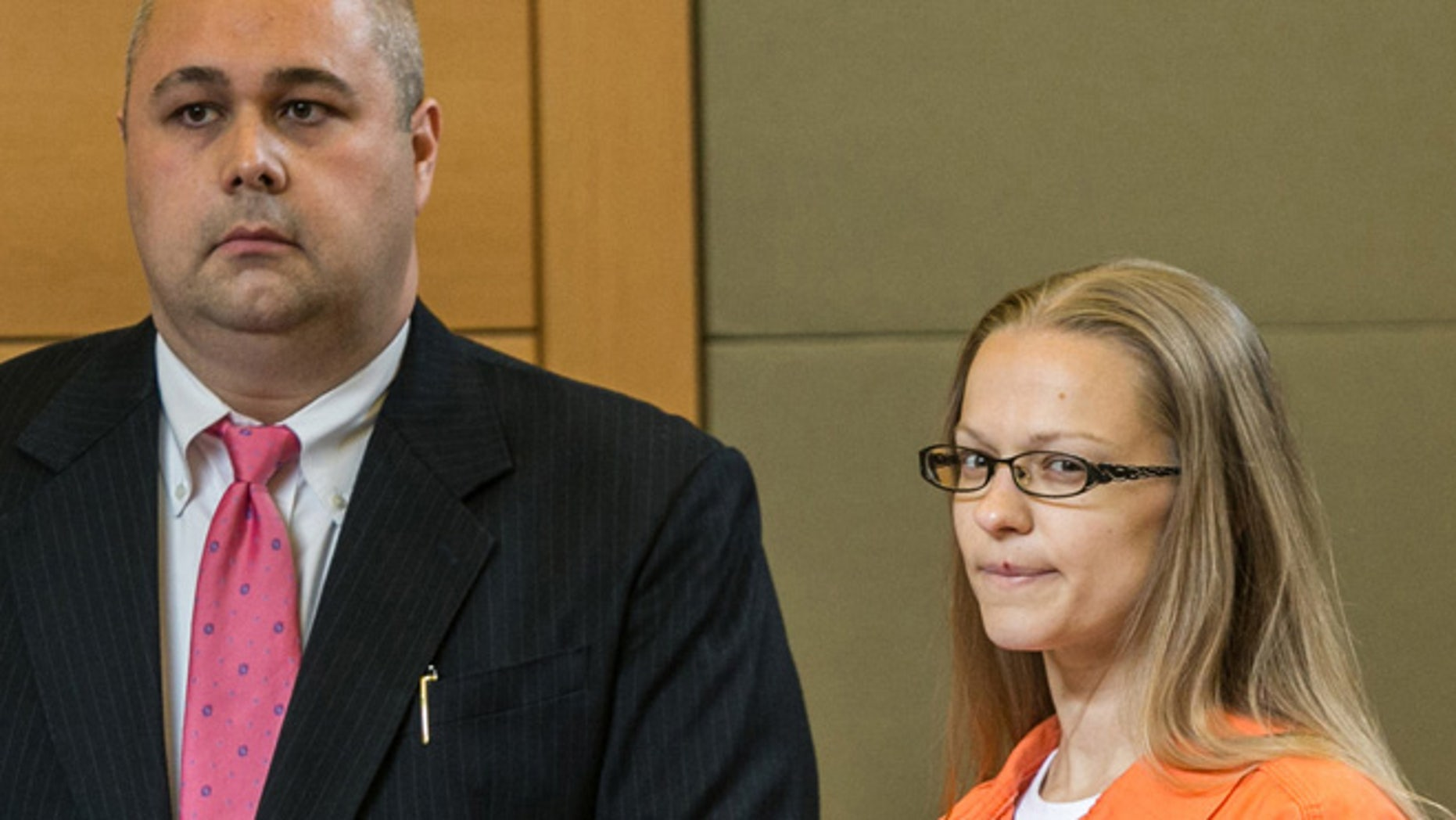 May 13: Angelika Graswald, right, stands in court with Michael Archer a forensic scientist, as her attorneys ask for bail and to unseal the indictment against her during a hearing, in Goshen, N.Y.