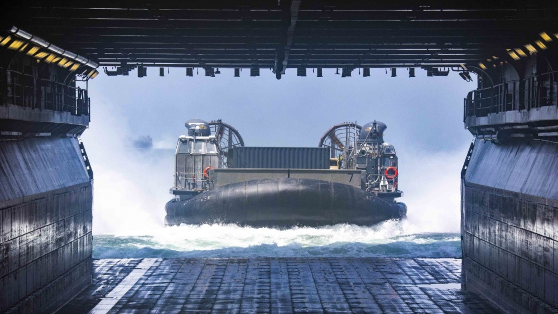 File photo - A Landing Craft Air Cushion approaches the well deck of the amphibious assault ship USS Kearsarge (LHD 3) (U.S. Navy photo by Mass Communication Specialist 3rd Class Kaitlyn E. Eads/Released)