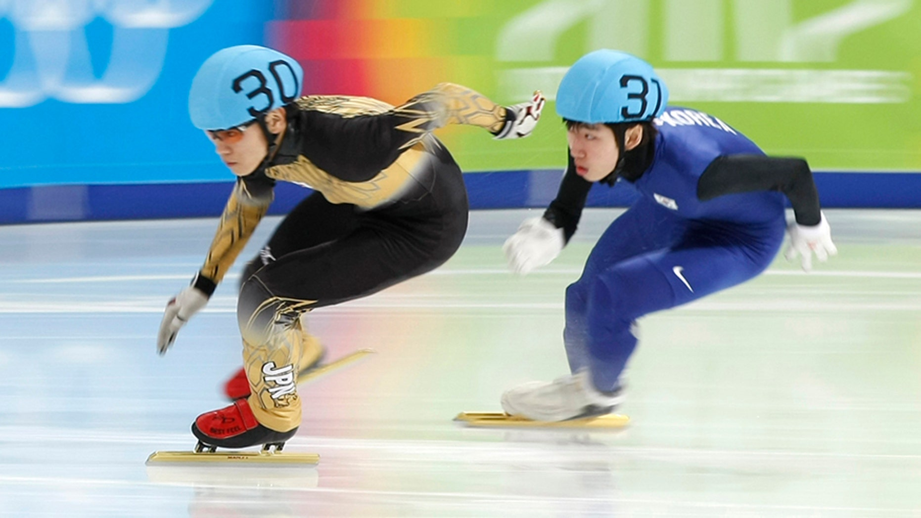 Jan. 19, 2012: Japan's Kei Saito, left, skates ahead of South Korea's Lim Hyo-Jun at the first winter Youth Olympic Games.