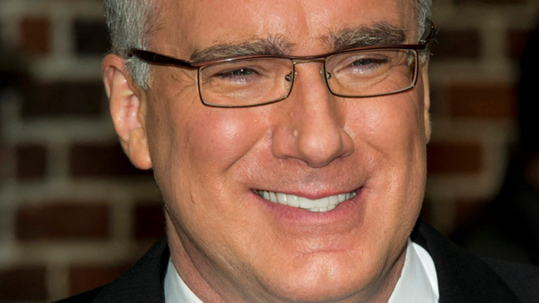 FILE - In this Oct. 24, 2011 file photo, political pundit Keith Olbermann leaves a taping of the 'Late Show with David Letterman' in New York.