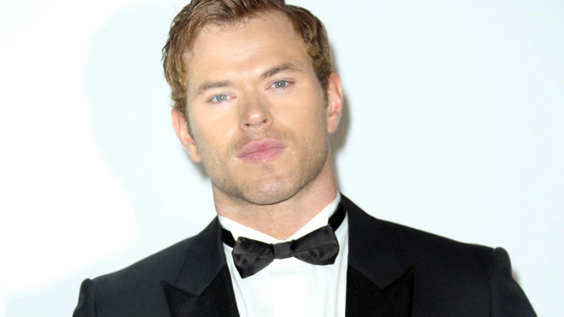 FILE - In this Thursday, May 22, 2014 file photo, actor Kellan Lutz arrives at the amfAR Cinema Against AIDS benefit at the Hotel du Cap-Eden-Roc, during the 67th international film festival, in Cap d'Antibes, southern France. Lutz and Robert Pattinson were in Cannes this week to promote projects: Pattinson had one film in competition at the film festival and one out of it, while Lutz was around town for his role in The Expendables 3. (Photo by Joel Ryan/Invision/AP-File)