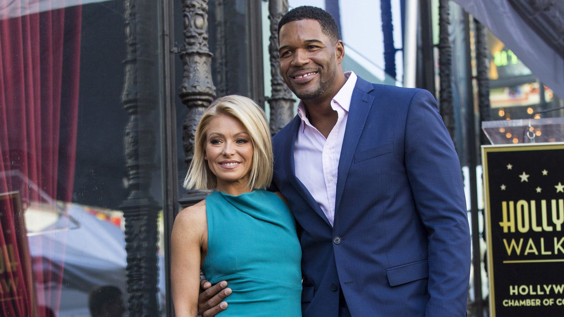 Kelly Ripa and Michael Strahan celebrate her star on the Hollywood Walk of Fame in 2015.