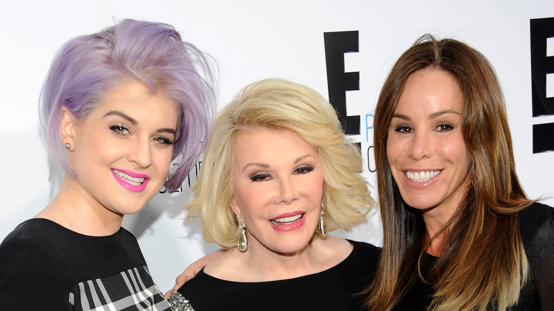 """April 30, 2012. Kelly Osbourne, left, and Joan Rivers, center, co-hosts of the show """"Fashion Police"""" and show producer Melissa Rivers pose at an E! Network upfront event in New York."""