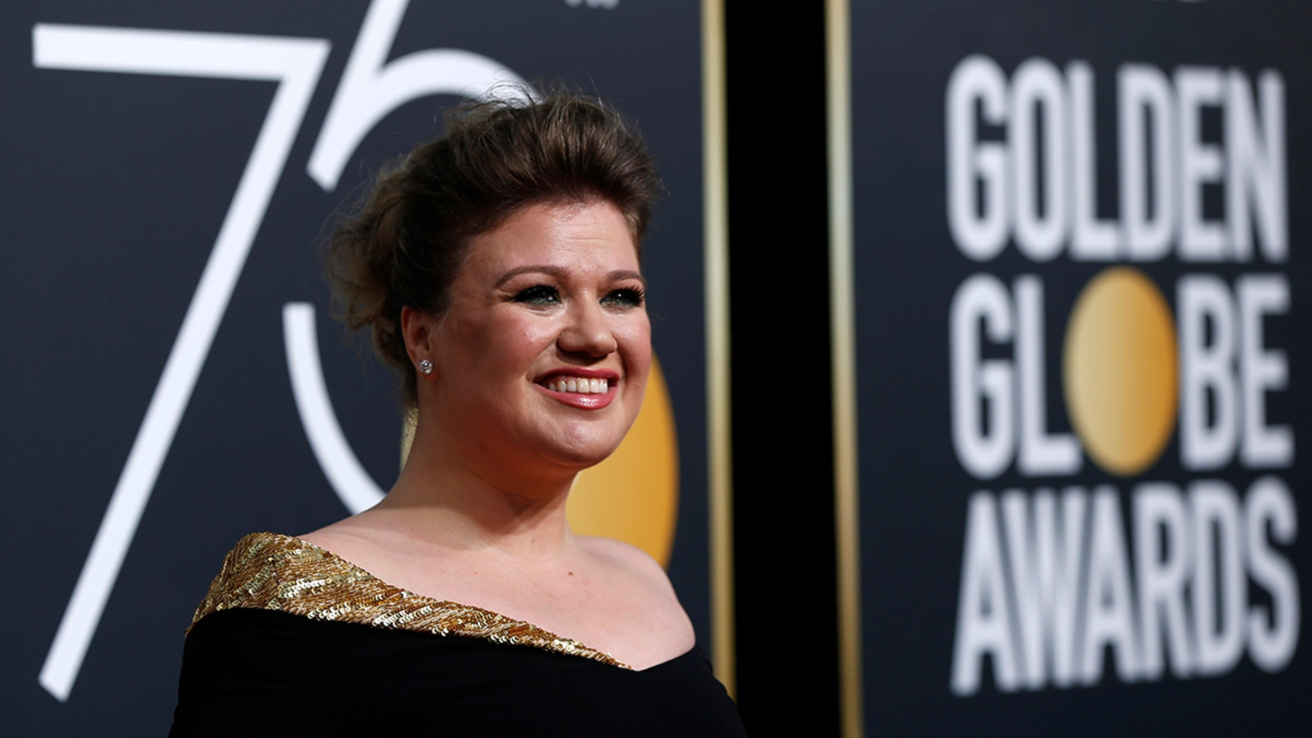 75th Golden Globe Awards – Arrivals – Beverly Hills, California, U.S., 07/01/2018 – Singer Kelly Clarkson. REUTERS/Mario Anzuoni - HP1EE171SPD52