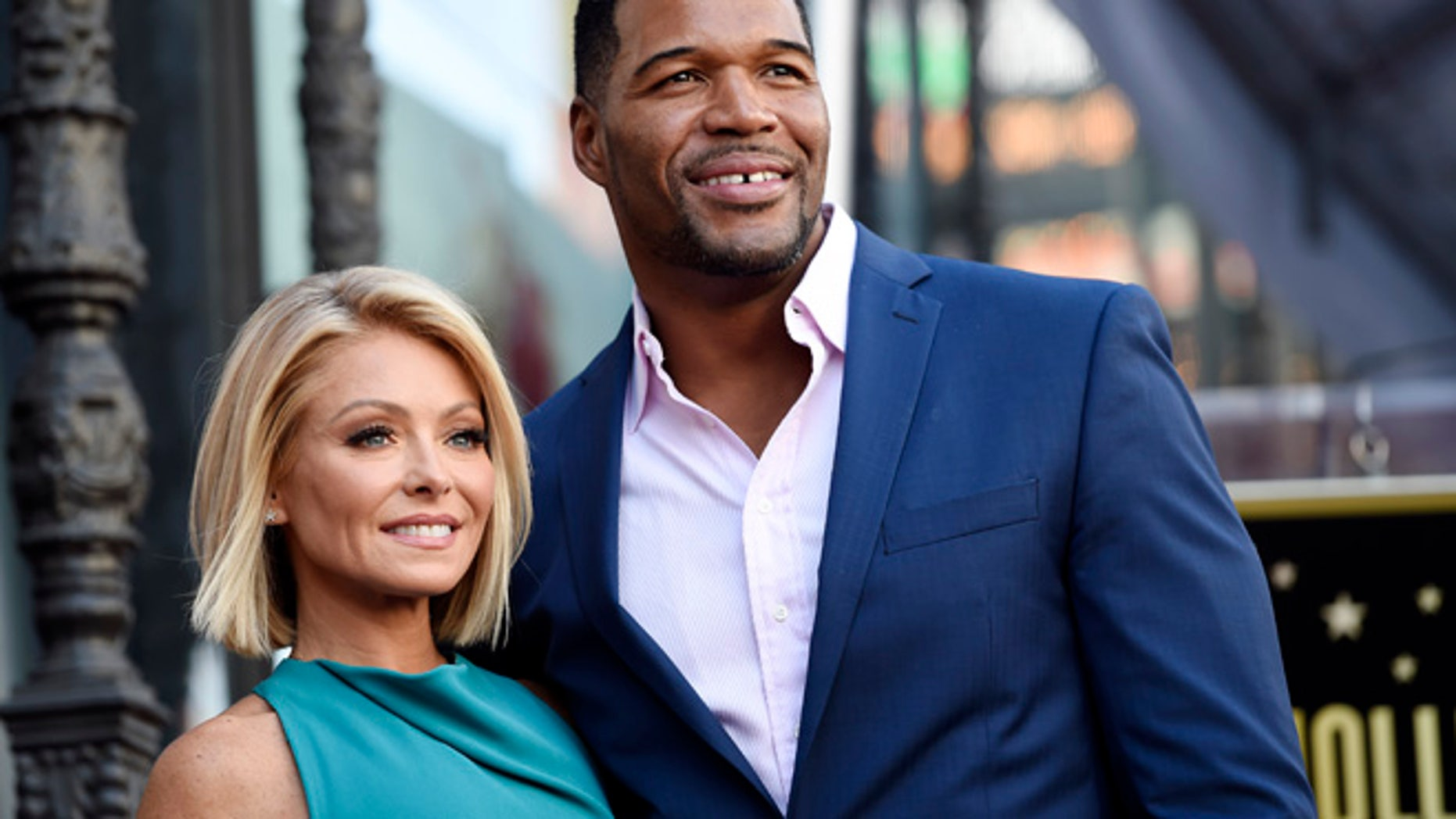 "In this Oct. 12, 2015 file photo, Kelly Ripa, left, poses with Michael Strahan, her co-host on the daily television talk show ""LIVE! with Kelly and Michael,"" during a ceremony honoring Ripa with a star on the Hollywood Walk of Fame in Los Angeles."