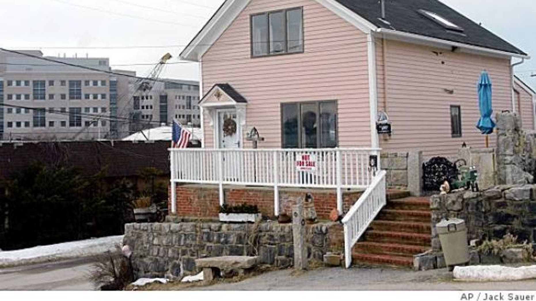 Feb. 8, 2005: The home of Susette Kelo in the Fort Trumbull section of New London, Conn. The small house once at the center of a U.S. Supreme Court decision on government seizure of private property was later disassembled and relocated to a site close to downtown New London. Avner Gregory, of New London, the new owner, dedicated his house on June 21, 2008, before a crowd of about 200 participants and onlookers. (AP/Jack Sauer)