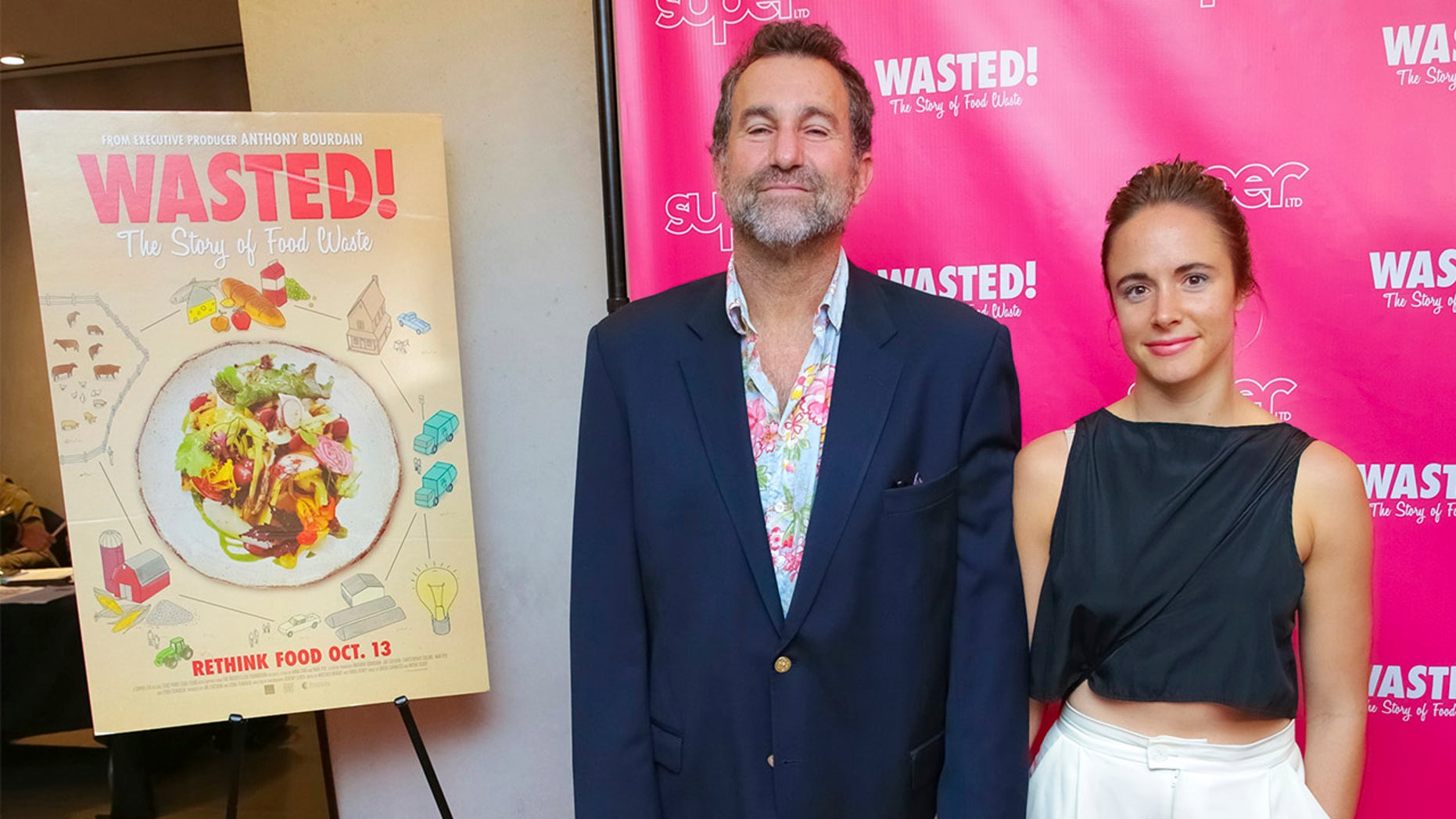 Restaurateur Ken Friedman, seen here with a guest at a 2017 film premiere, has been accused of sexual harassment by his former employees.