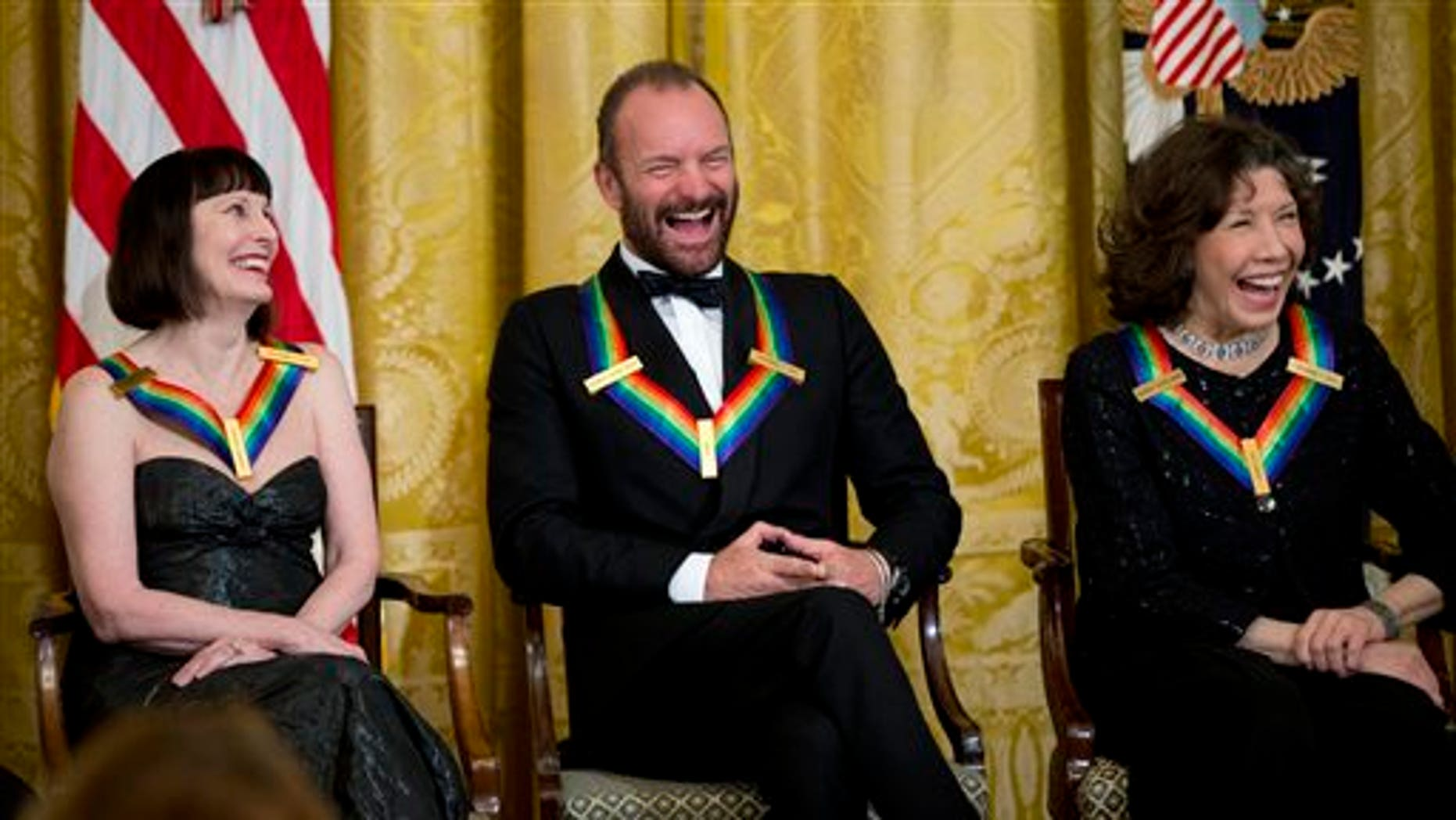 The 2014 Kennedy Center Honors Honorees ballerina Patricia McBride, from left, singer-songwriter Sting, and comedienne Lily Tomlin, laugh during a reception in their honor in the East Room of the White House in Washington, Sunday, Dec. 7, 2014, hosted by President Barack Obama and first lady Michelle Obama.   (AP Photo/Manuel Balce Ceneta)