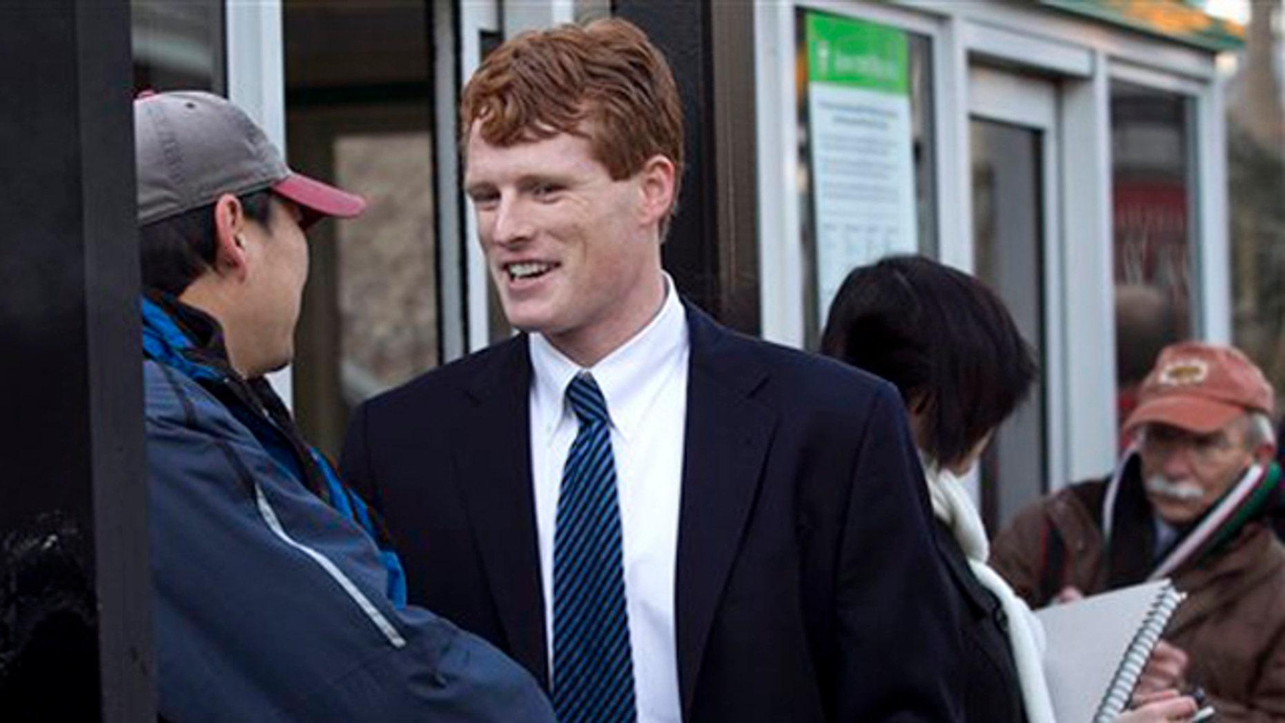 Feb. 16, 2012: Joseph Kennedy III greets commuters in Newton, Mass.
