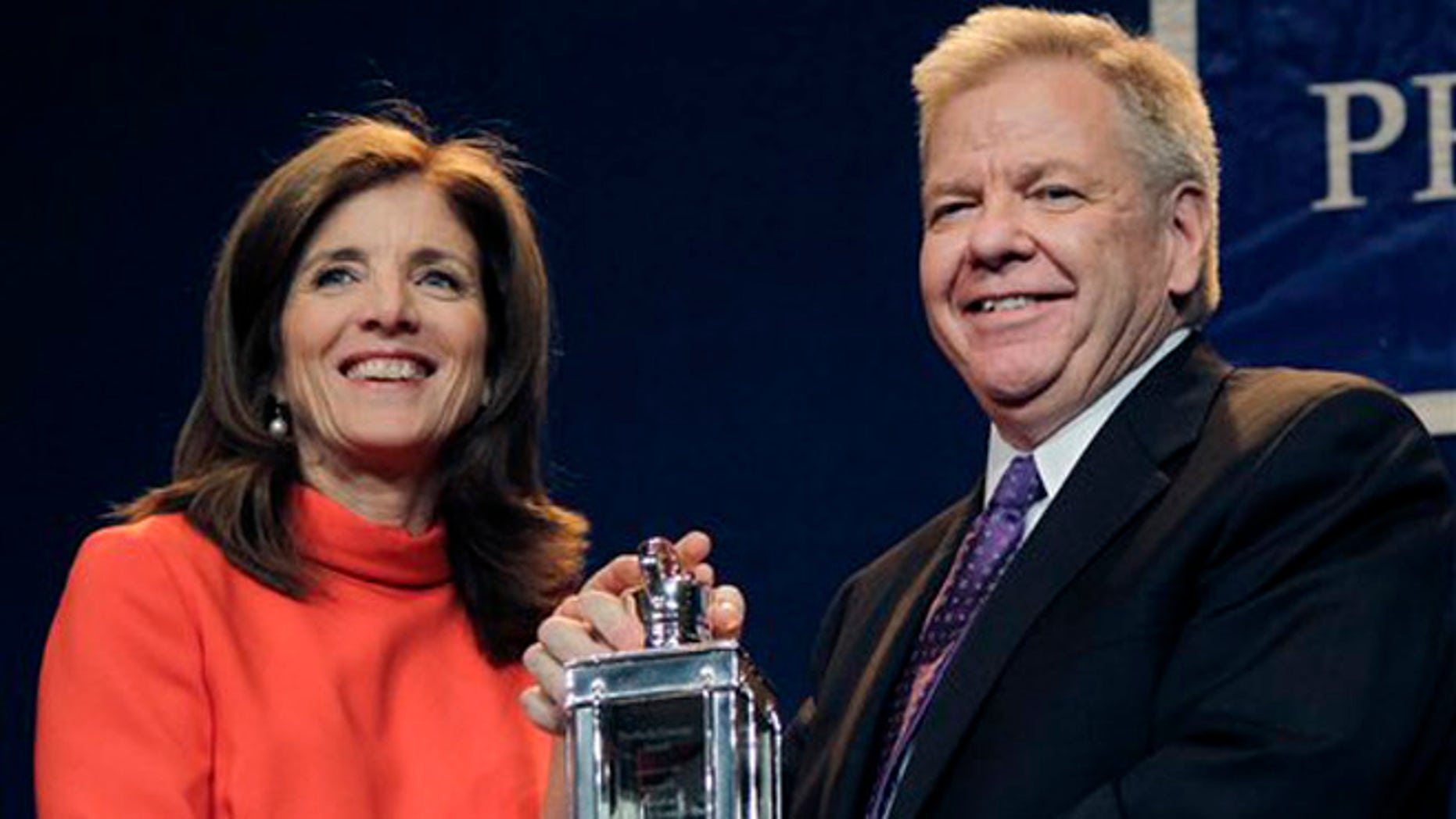 May 7, 2012: Caroline Kennedy, left, presents the 2012 John F. Kennedy Profile in Courage Award to Michael Streit, former Iowa Supreme Court Justice, during a ceremony at the JFK Library in Boston.