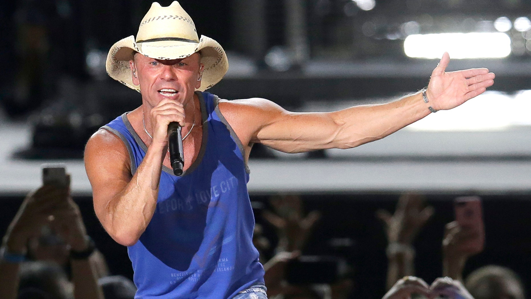 "In this June 23, 2018 file photo, Kenny Chesney performs during the Trip Around the Sun Tour in Phoenix. After Hurricane Irma decimated the U.S. Virgin Islands last year, country superstar Kenny Chesney started writing songs and organizing relief efforts. Chesney is donating proceeds from the sale of his new album, ""Songs for the Saints,"" to a foundation he set up to support recovery on the islands."