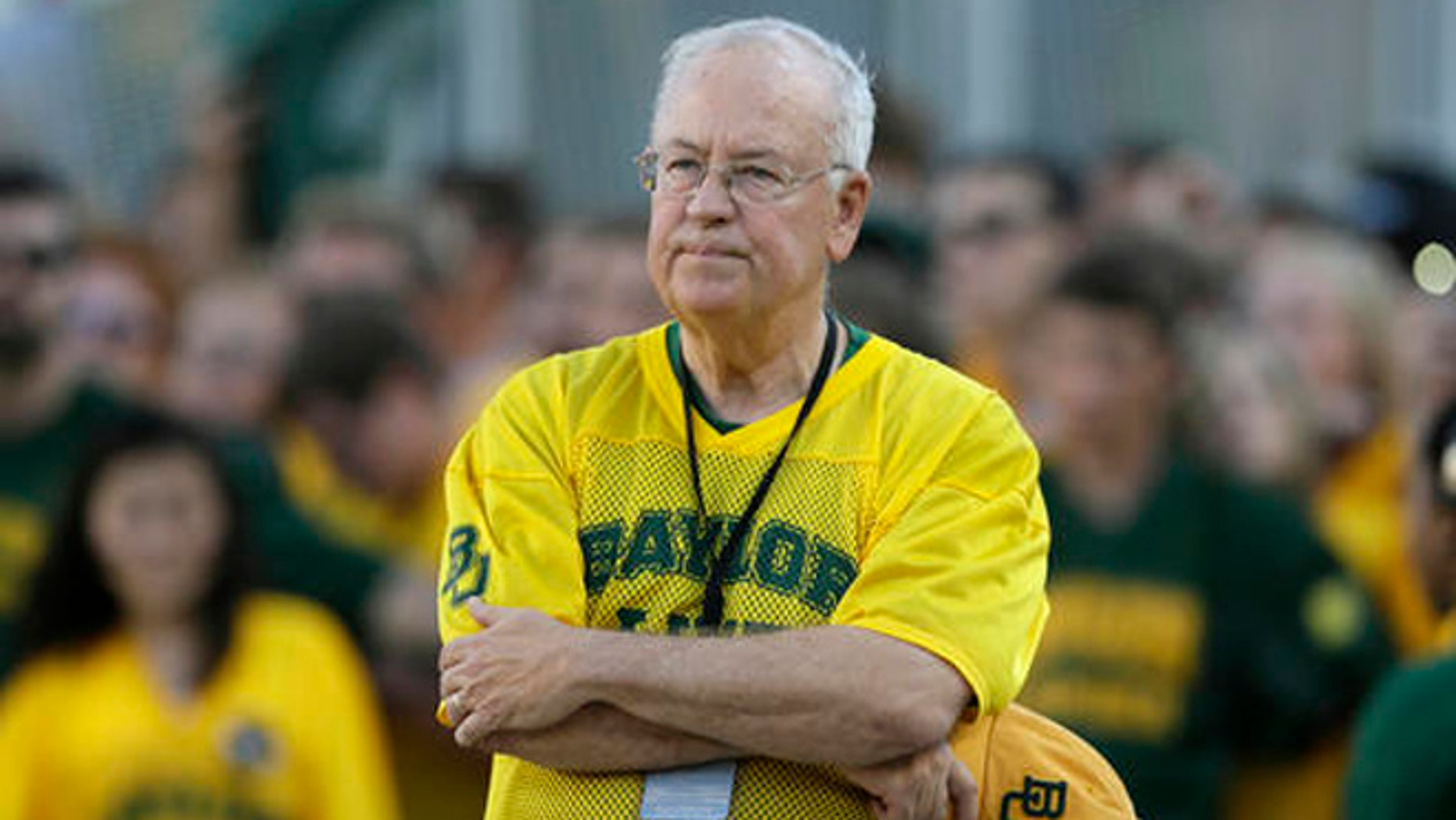 In the Sept. 12, 2015 file photo, Baylor President Ken Starr waits to run onto the field before an NCAA college football game in Waco, Texas.