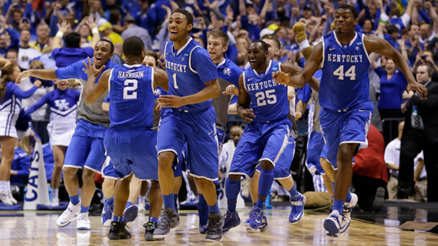 March 30, 2014: Kentucky players celebrate after an NCAA Midwest Regional final college basketball tournament game against Michigan to advance to the Final Four.
