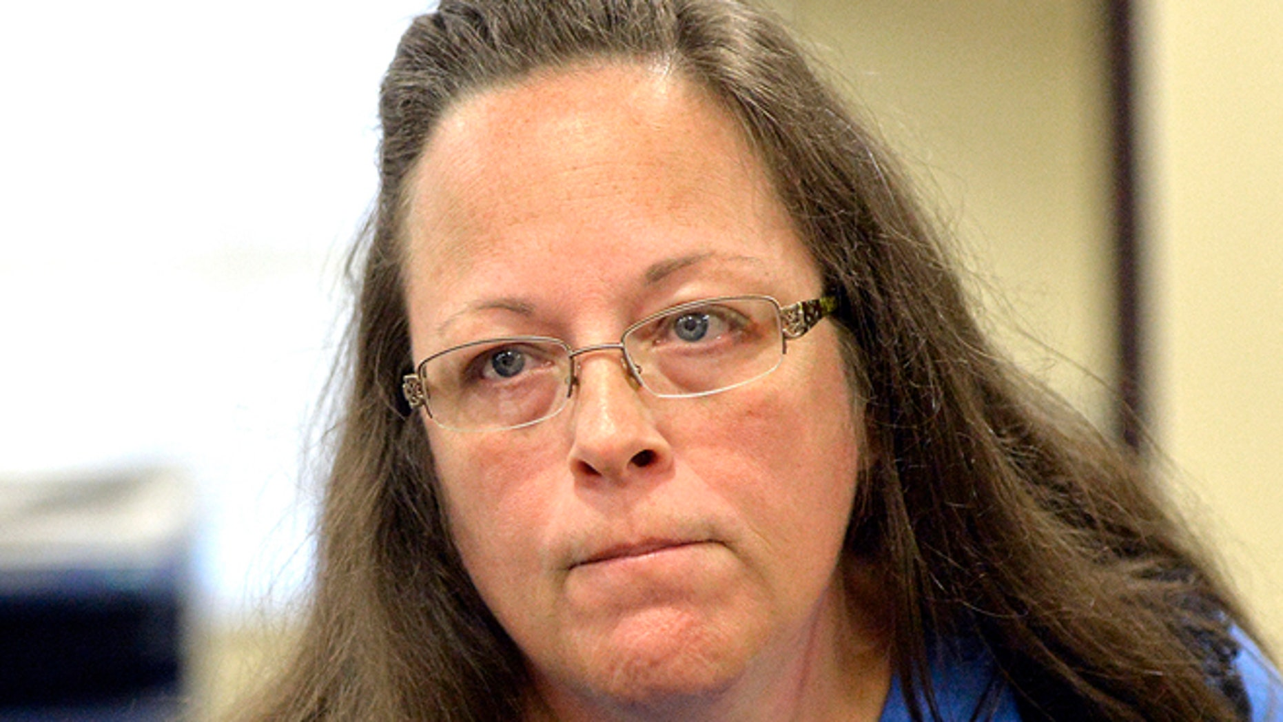 Sept. 1, 2015: Rowan County Clerk Kim Davis listens to a customer following her office's refusal to issue marriage licenses at the Rowan County Courthouse in Morehead, Ky.