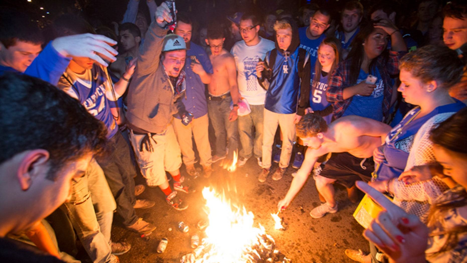 April 4, 2015: Kentucky fans set fire to shirts and hoodies as they gather near the University of Kentucky campus, in Lexington, Ky., after Wisconsin defeated Kentucky 71-64 in the semifinals of the NCAA men's college basketball tournament Final Four.
