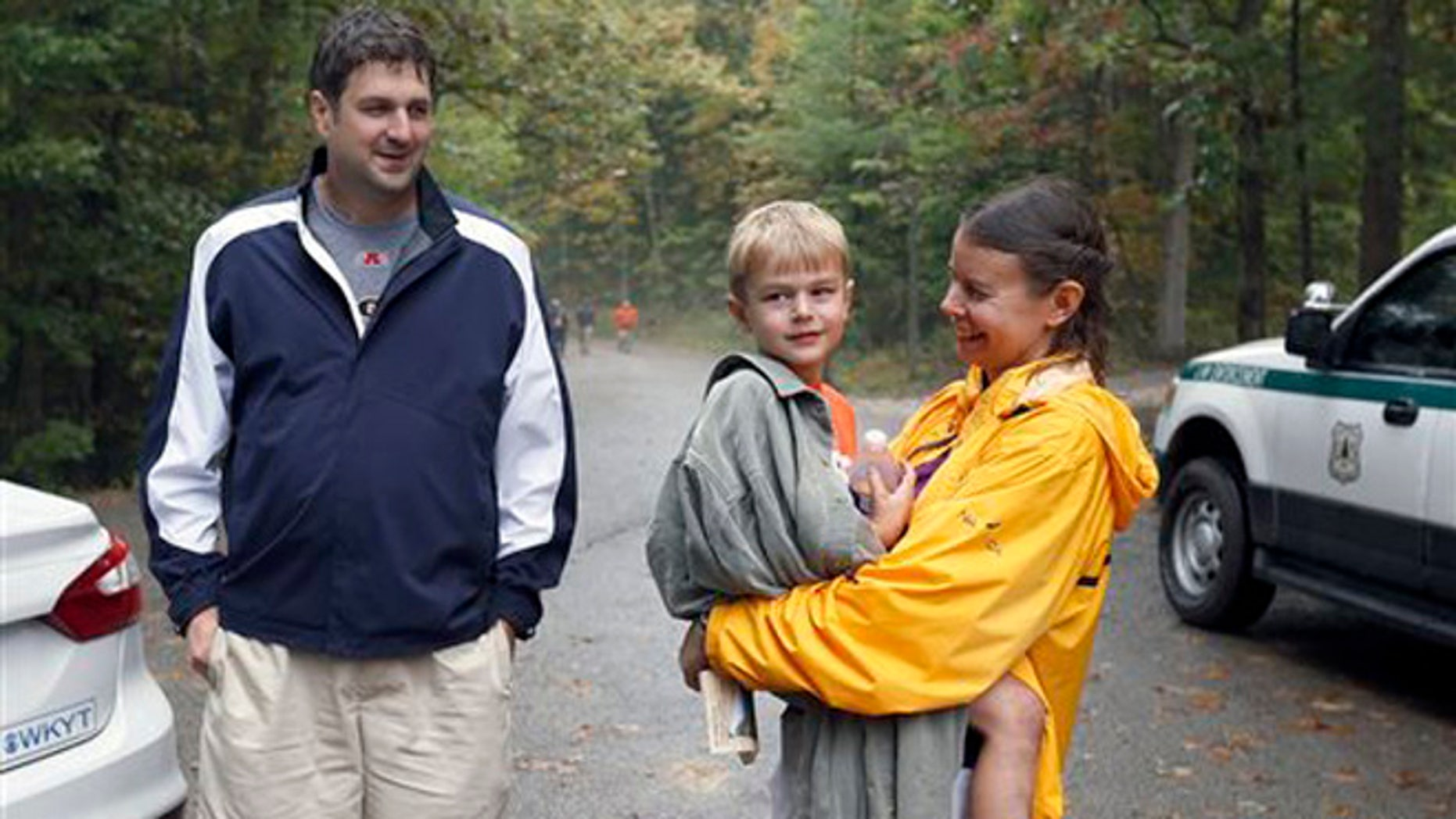Oct. 9, 2015: Dave and Julia Esposito with their son, Michael after he was found near the Koomer Ridge Campground in the Red River Gorge, near Slade, Ky.
