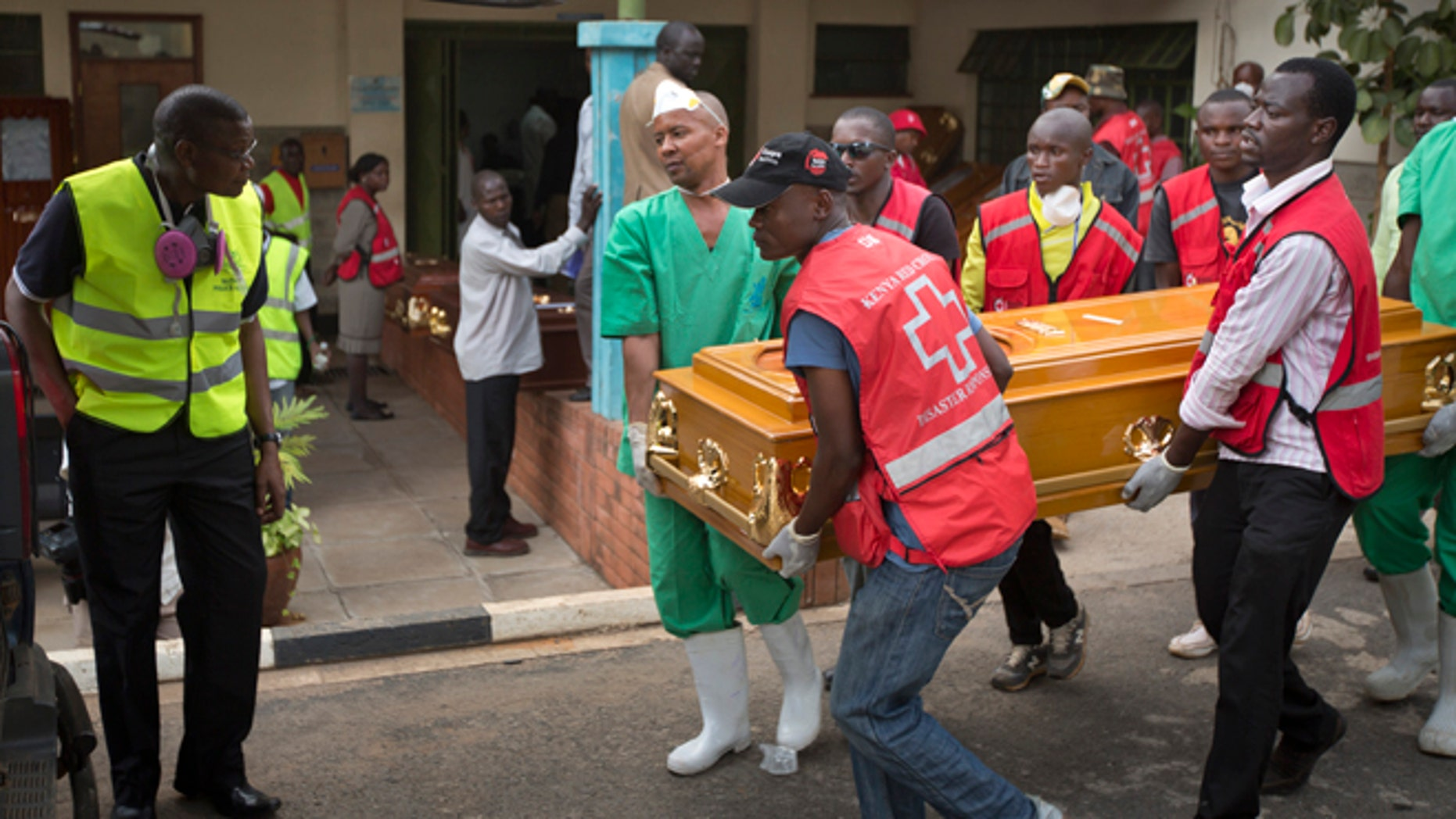 April 8, 2015: Morgue workers and Red Cross staff help to carry out the coffin of student Mildred Yondo, who was killed in last week's attack by extremist group Al-Shabasb at Garissa University, from the Chiromo Funeral Parlour in Nairobi, Kenya.