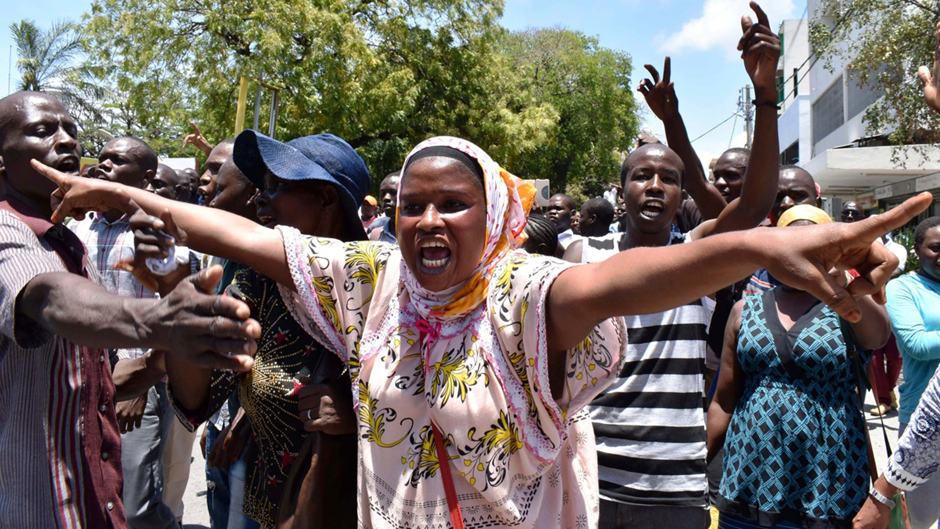 A National Super Alliance supporter shouts slogans after police prevented them from going to the IEBC offices in Mombasa, Kenya, Monday, Oct. 2, 2017.