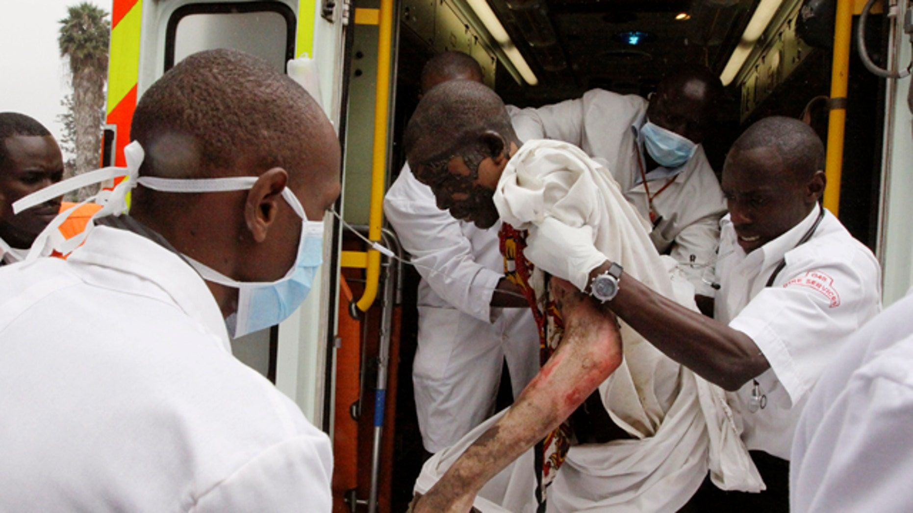 Sept. 12: A person injured in a gasoline pipeline incident is brought to Kenyatta National Hospital in Nairobi, Kenya. A local official says at least 61 bodies have been recovered after an explosion of a gasoline pipeline running through a slum in Kenya's capital.