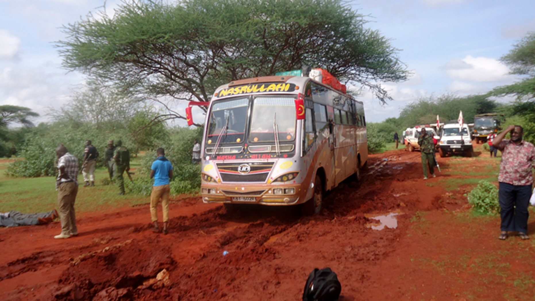 Nov. 22, 2014: Kenyan security forces and others gather around the scene on an attack on a bus about 31 miles outside the town of Mandera, near the Somali border in northeastern Kenya. (AP)