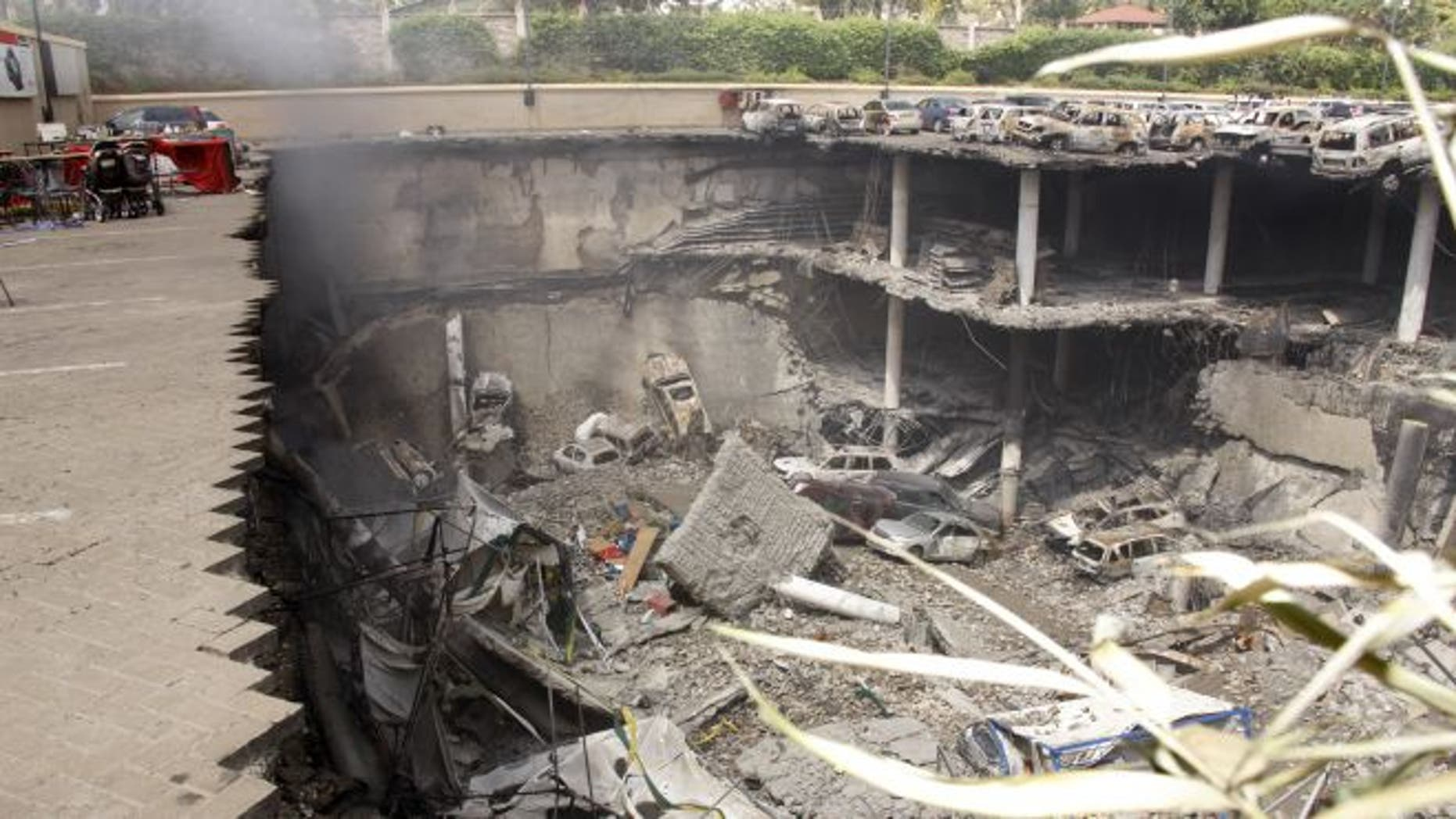 FILE: Sept. 26, 2013: This image shows the collapsed upper car park of the Westgate Mall in Nairobi, Kenya.