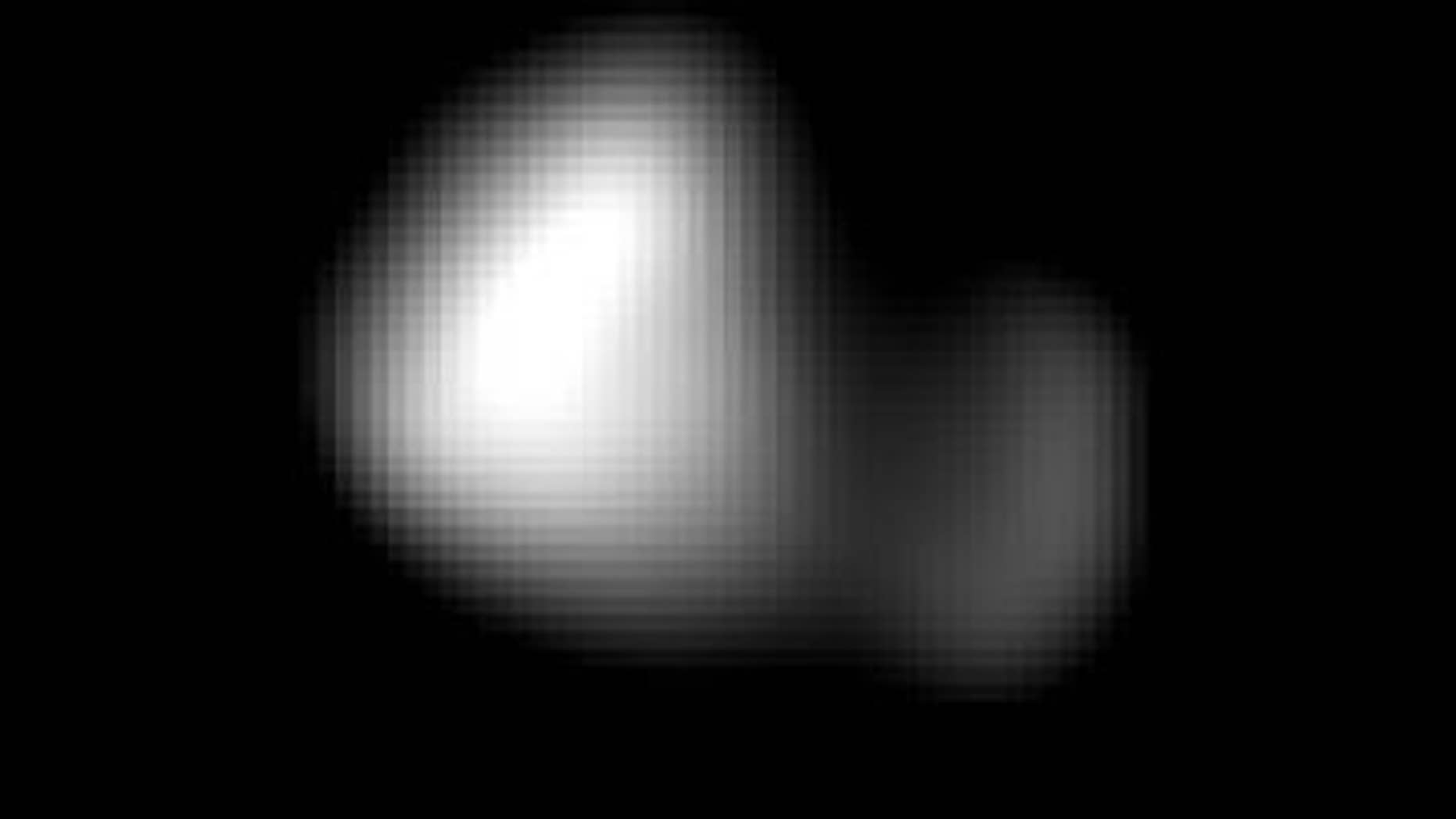 This image of Kerberos was created by combining four individual Long Range Reconnaissance Imager pictures taken on July 14, approximately seven hours before New Horizons' closest approach to Pluto, at a range of 245,600 miles from Kerberos. Kerberos appears to have a double-lobed shape, approximately 7.4 miles across in its long dimension and 2.8 miles in its shortest dimension. (NASA/Johns Hopkins University Applied Physics Laboratory/Southwest Research Institute)