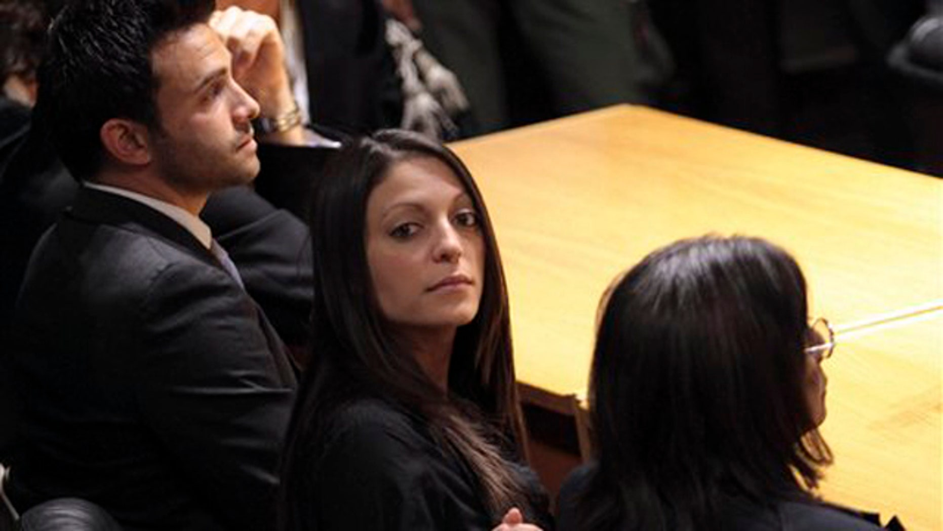 From left, Meredith Kercher's brother Lyle, sister Stephanie and mother Arline wait for the verdict in the Amanda Knox appeals trial at the Perugia court, Italy, Monday Oct. 3, 2011.