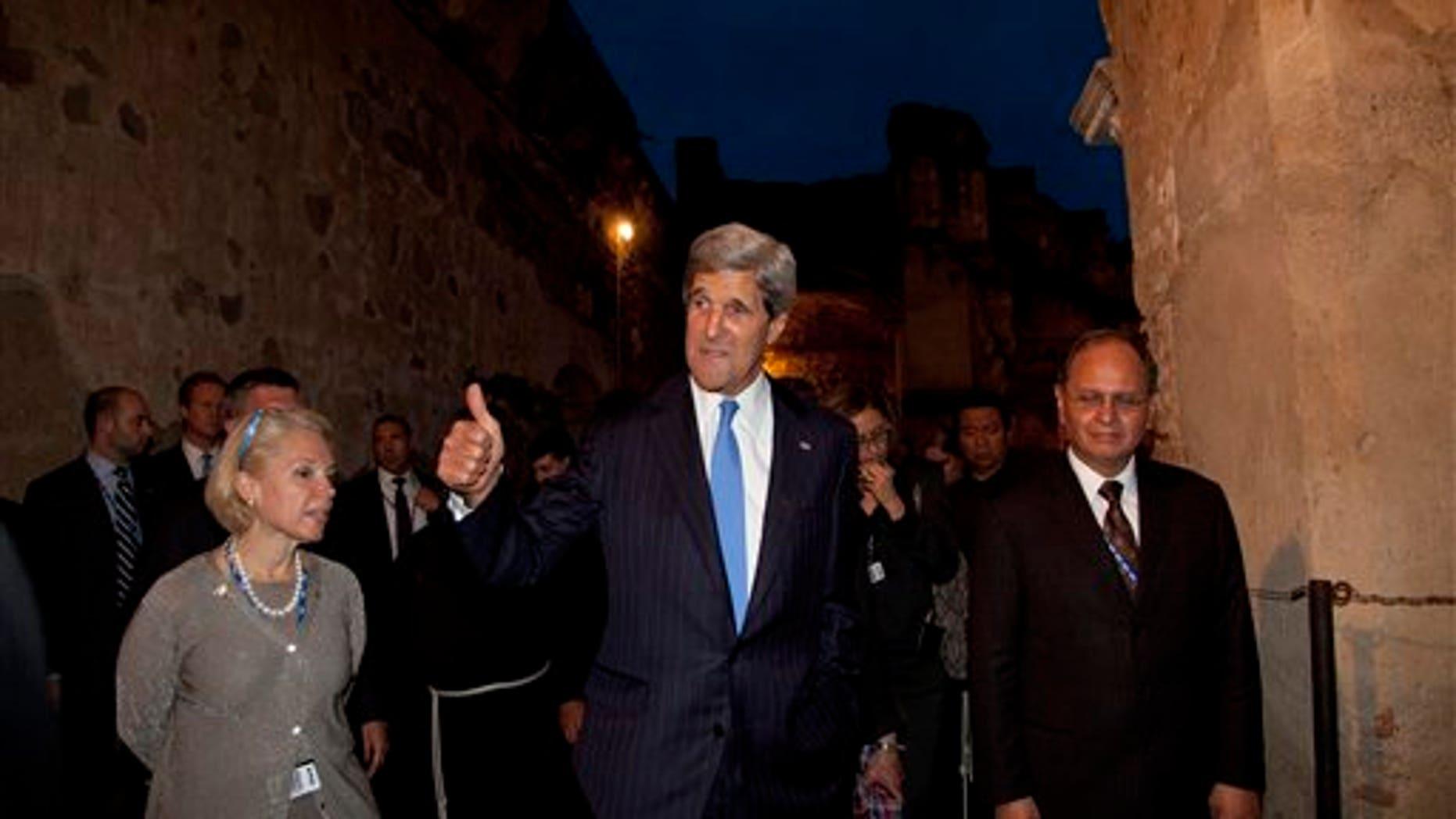 U.S. Secretary of State John Kerry visiting San Francisco Church in Antigua Guatemala, Tuesday, June 4, 2013.