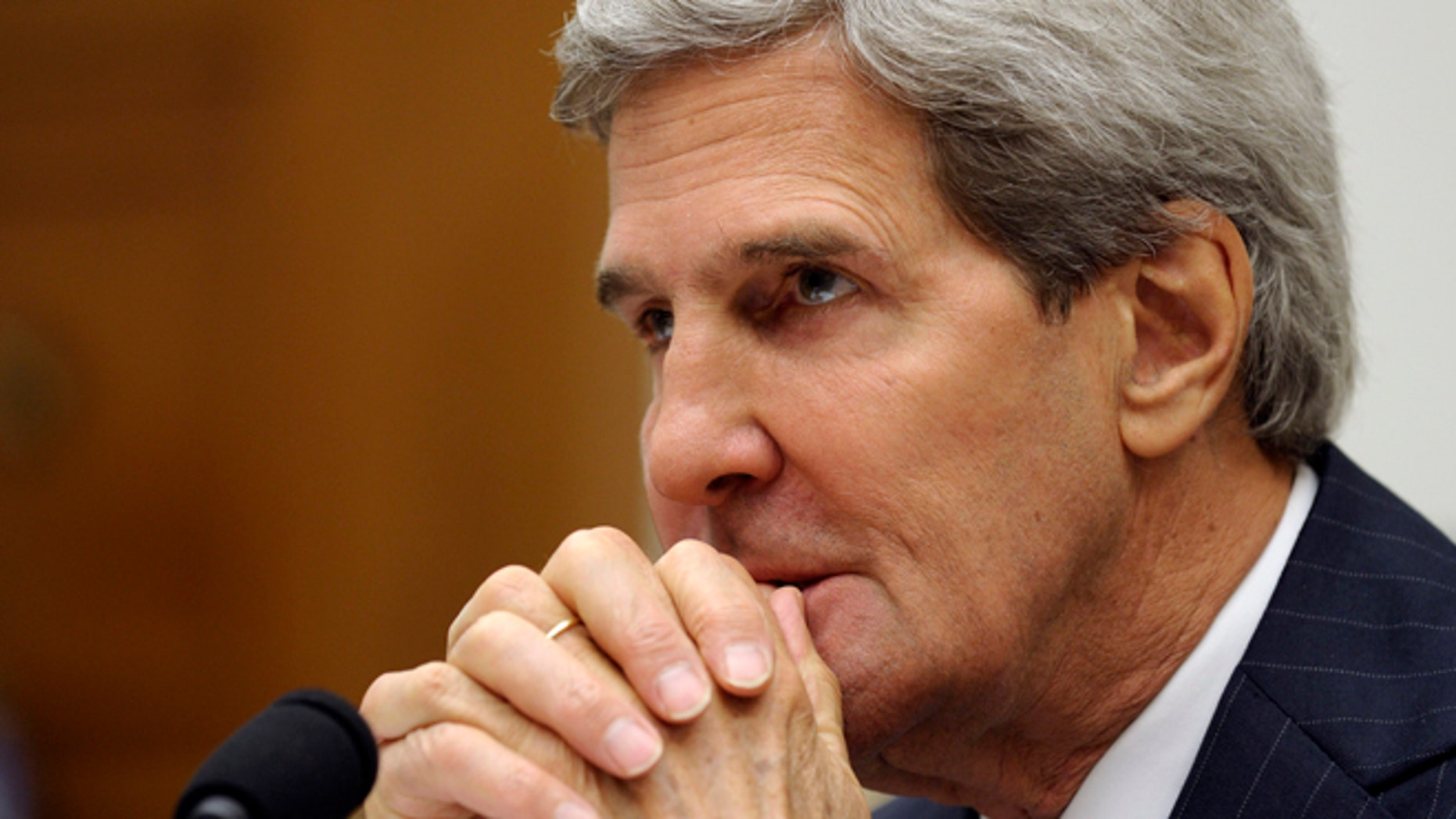 FILE: Sept. 10, 2013: Secretary of State John Kerry waits to testify on Capitol Hill in Washington, D.C.