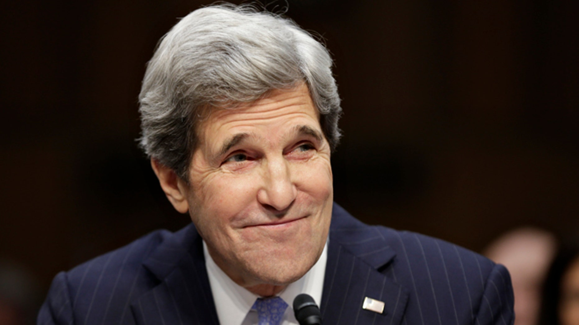 FILE: Jan. 24, 2013: Then-Sen. John Kerry, D-Mass., sits before a Senate committee during his confirmation hearing to be secretary of State.