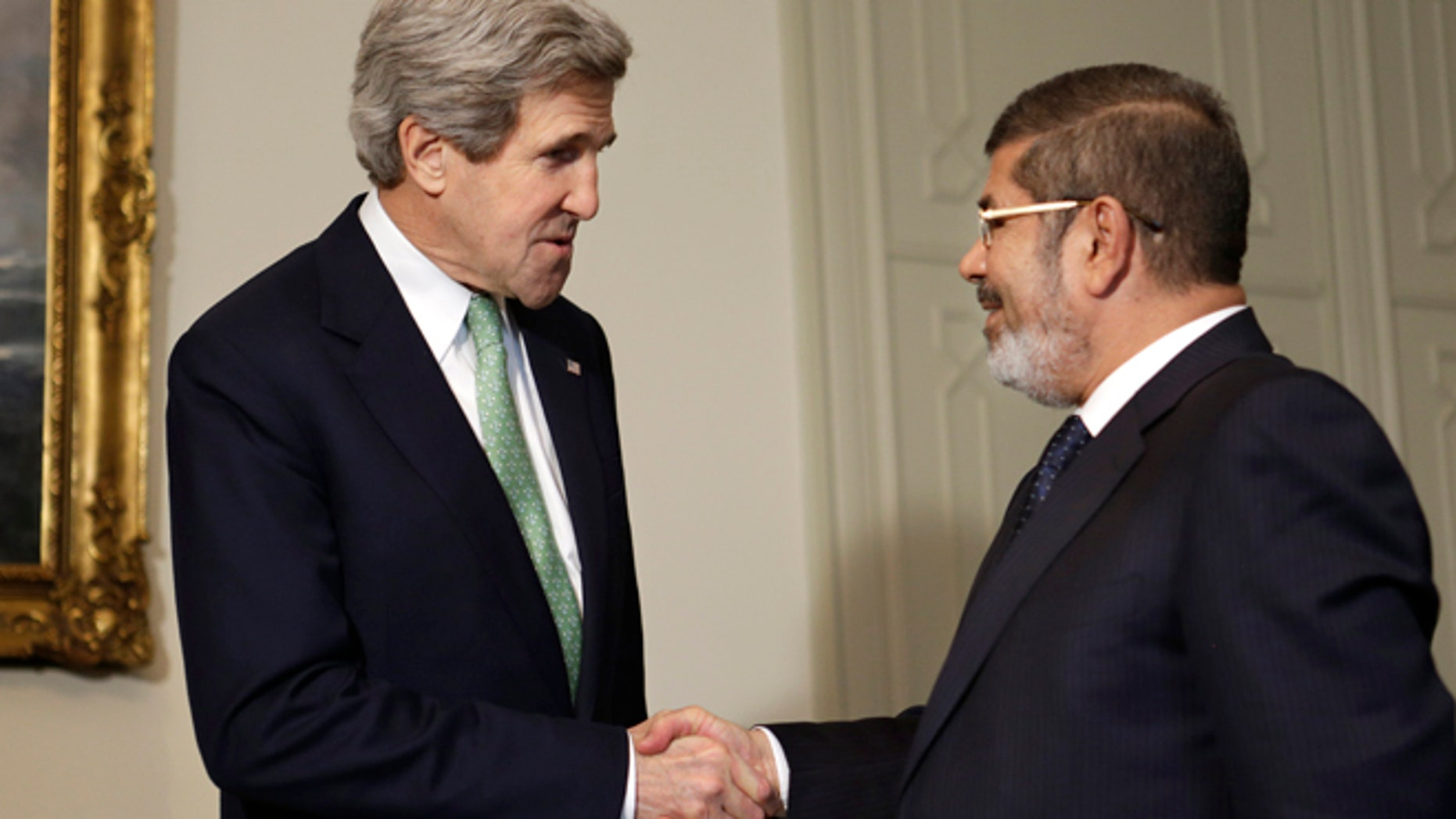March 3, 2013: U.S. Secretary of State John Kerry, left, shakes hands with Egyptian President Mohamed Morsi at the Presidential Palace in Cairo, Egypt. U.S. Secretary of State John Kerry met with Egypt's president Sunday, wrapping up a visit to the deeply divided country with an appeal for unity and reform. The U.S. is deeply concerned that continued instability in Egypt will have broader consequences in a region already rocked by unrest.
