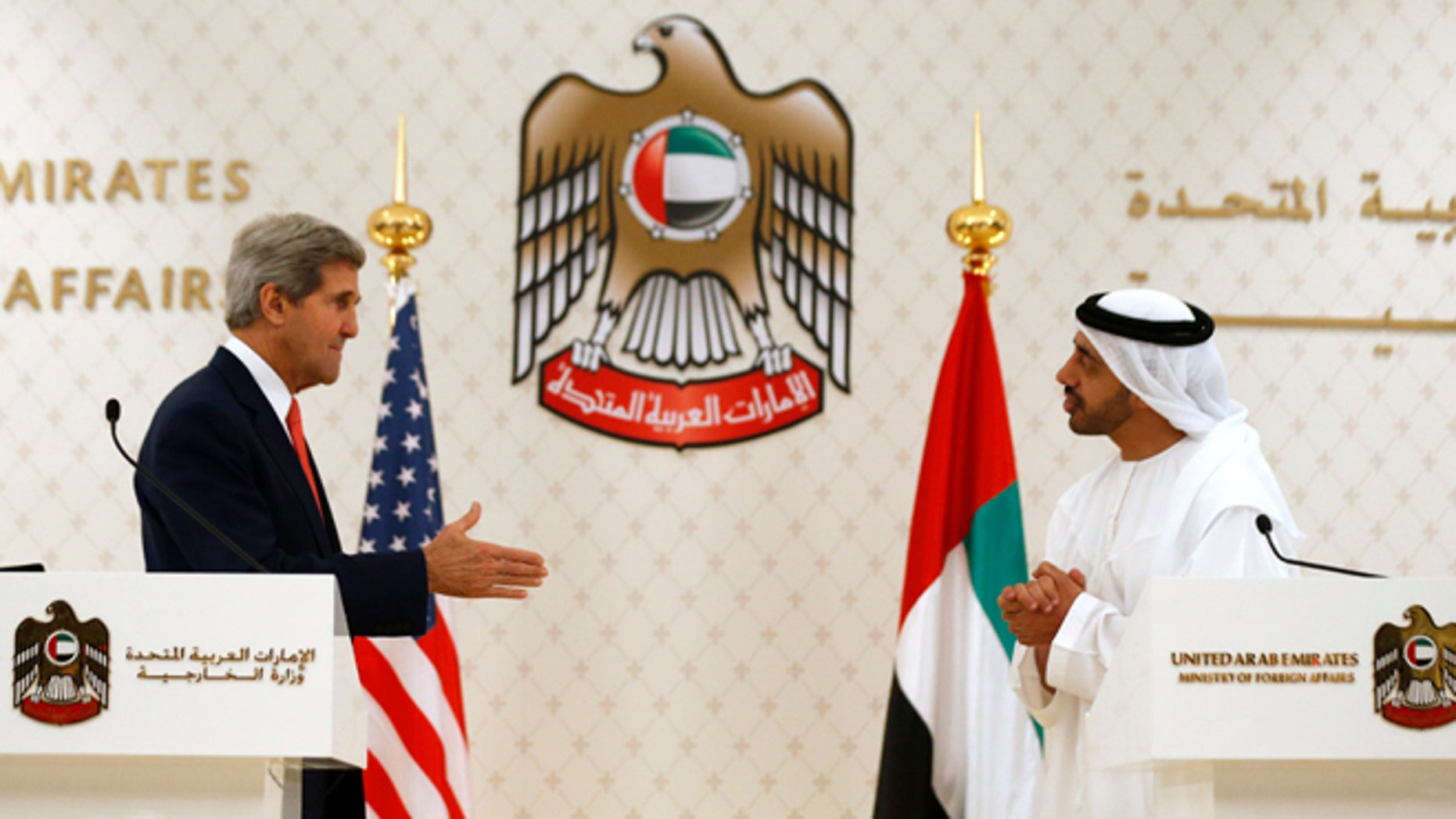 Nov. 11, 2013: U.S. Secretary of State John Kerry reaches out to shake hands with U.A.E. Foreign Minister Abdullah bin Zayed Al Nahyan in Abu Dhabi. The U.A.E. is one of the biggest buyers of U.S. arms.
