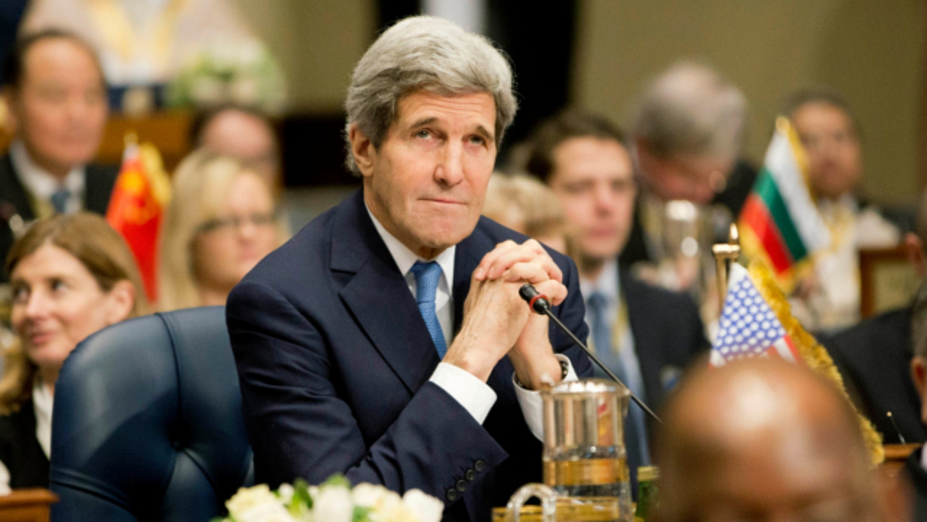 Jan. 15, 2014: Secretary of State John Kerry attends the opening session of the Syria Donors' Conference at Bayan Palace Liberation Hall in Kuwait.