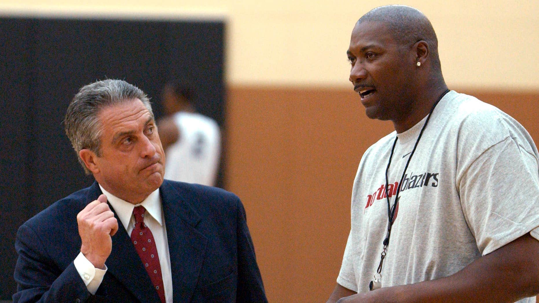 July 16, 2003: Portland Trail Blazers general manager John Nash, left, chats with assistant coach Jerome Kersey after the NBA basketball team's practice in Tualatin, Ore.