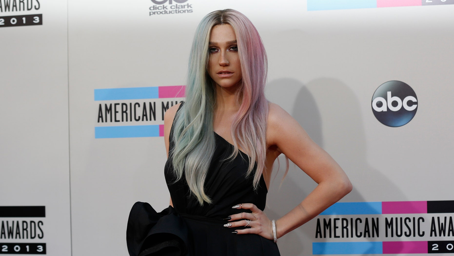 November 24, 2013. Ke$ha arrives at the 41st American Music Awards in Los Angeles, California.