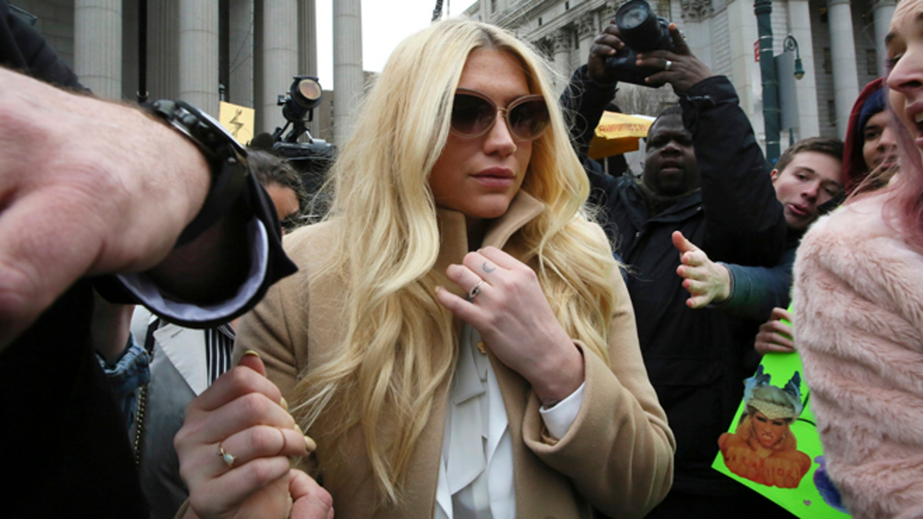 Feb. 19, 2016. Pop star Kesha leaves Supreme court in New York after a hearing involving her producer, Dr. Luke.